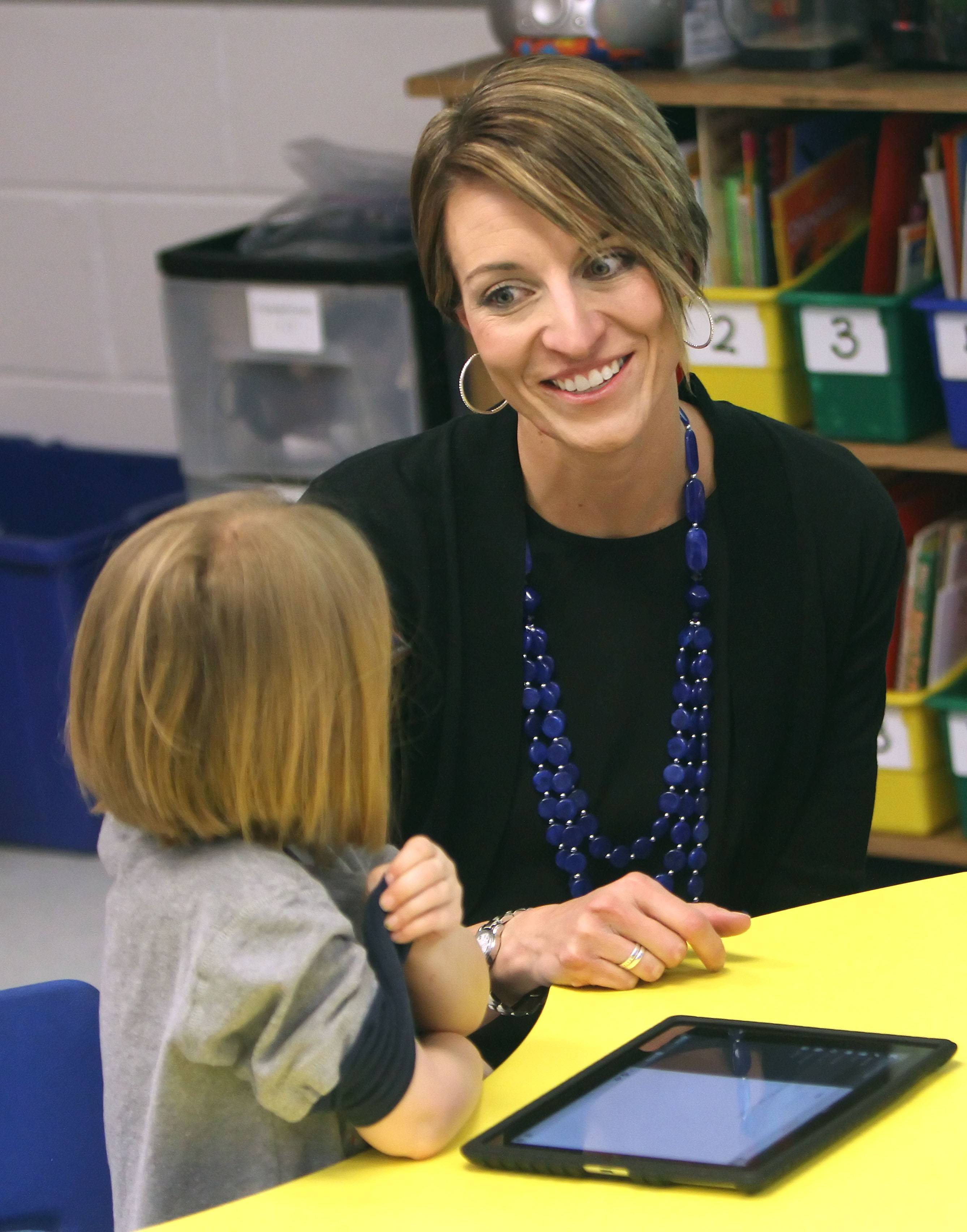 Technology Coach Allison Honaker helps kindergartner Meghan O'Donnell as kids learn how to create a blog at Oak Grove Elementary School in Green Oaks.