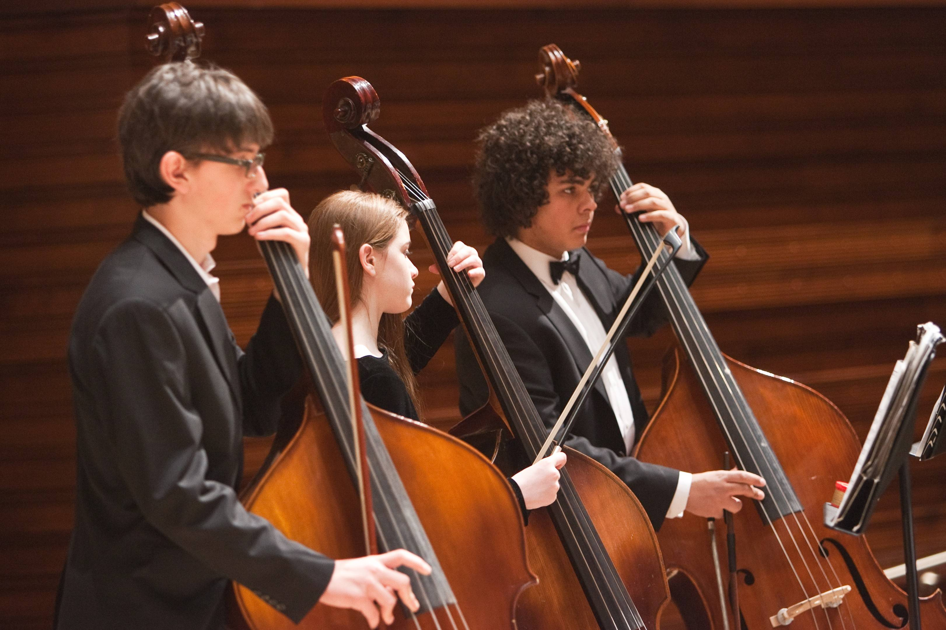 Performing on basses are, from left, Ceazar DePaoli, Rachel Shapley and Benjamin Alston.
