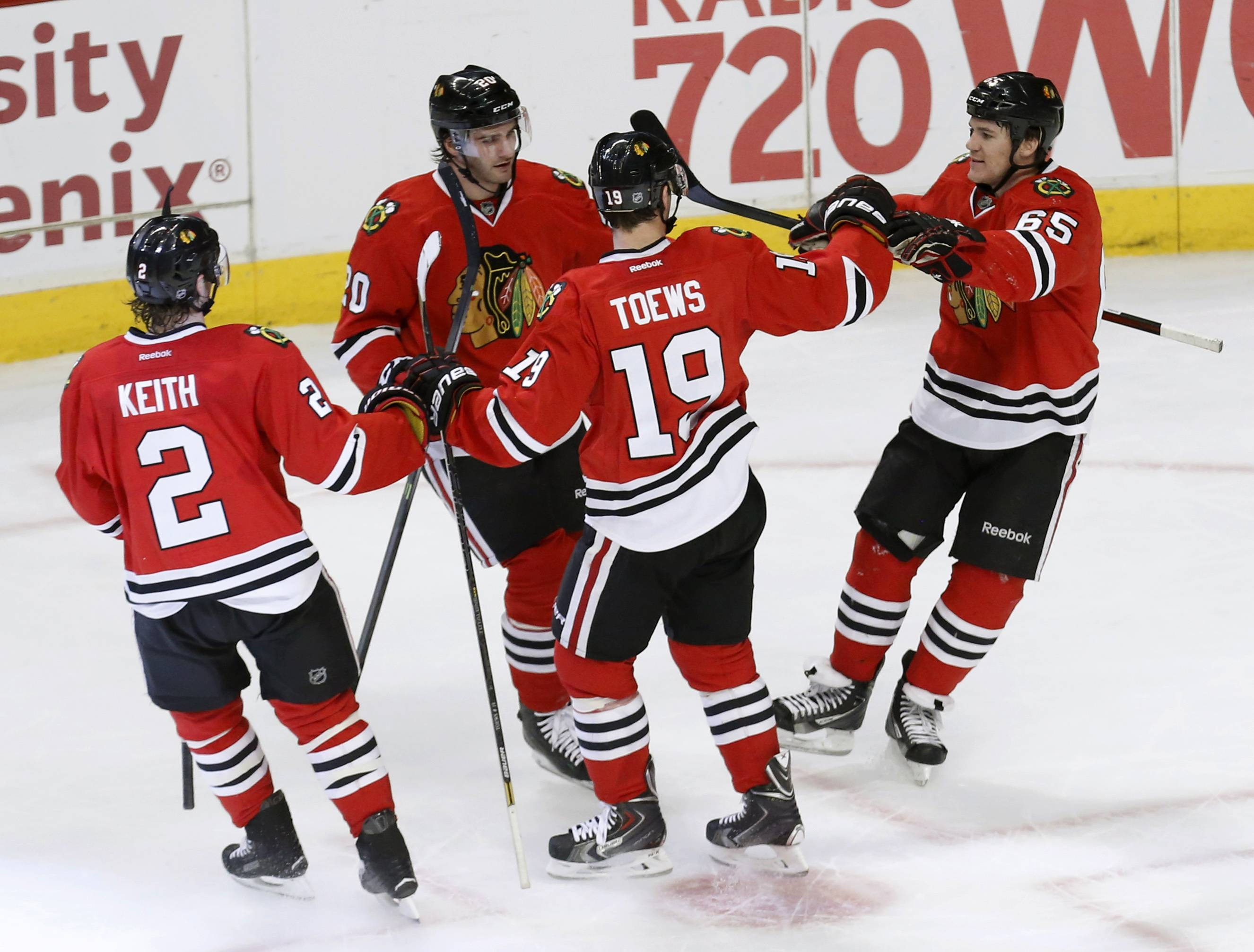 Andrew Shaw, far right, celebrates his goal with teammates Duncan Keith, Brandon Saad and Jonathan Toews. Shaw and Toews each had 2 goals in the Hawks' rout of the Blue Jackets.