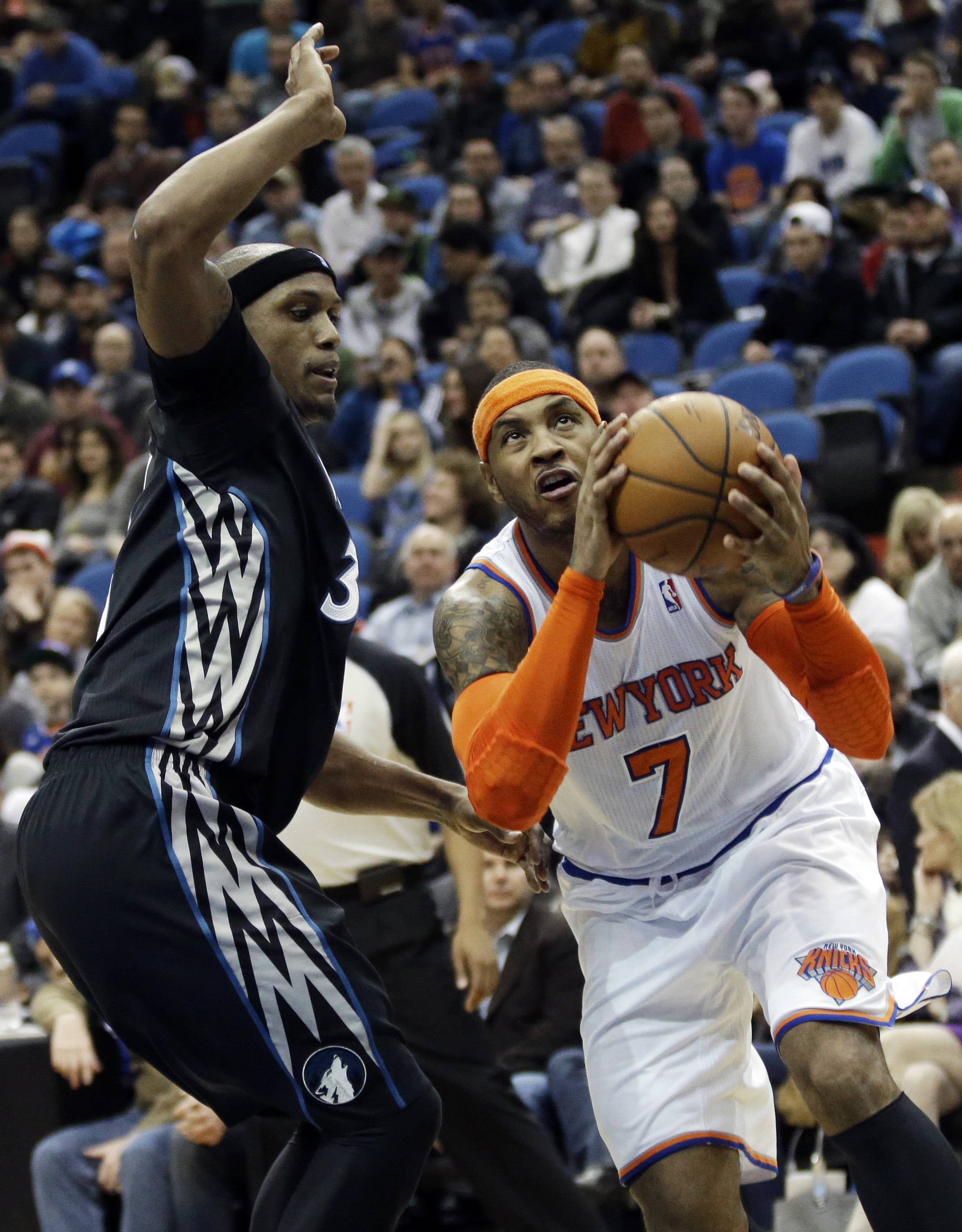 The Knicks' Carmelo Anthony, driving around the Timberwolves' Dante Cunningham on Wednesday, finished with 33 points in New York's 118-106 victory.