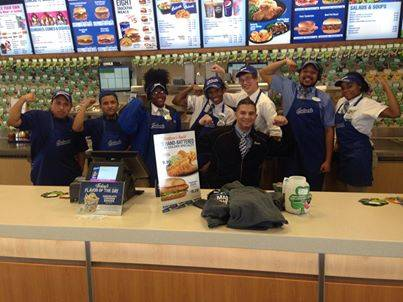 Culver's Team Members flex muscles and display donated shamrocks in support of Muscular Dystrophy Association.