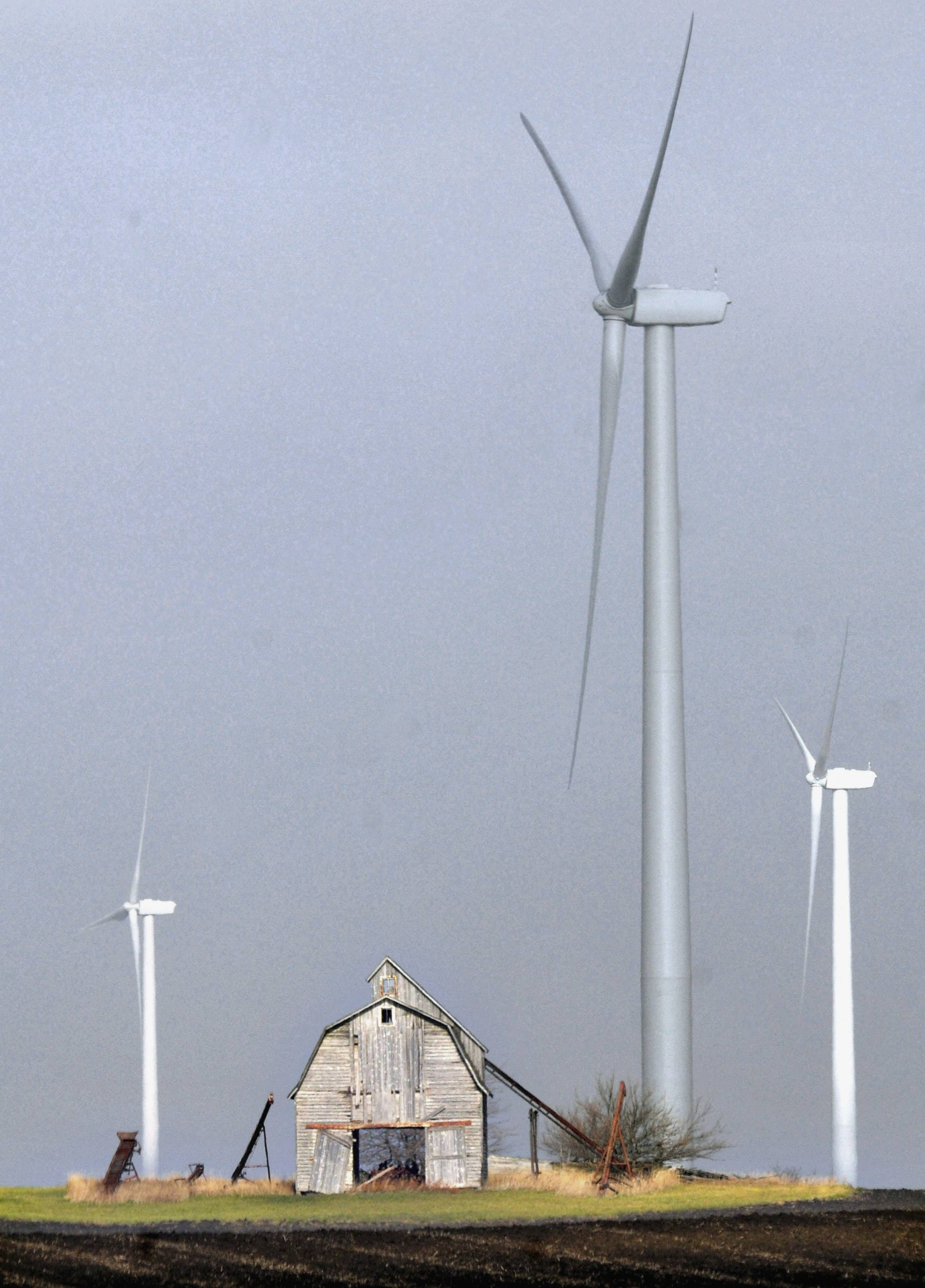 Several wind turbines produce electricity east of Paxton, Ill.
