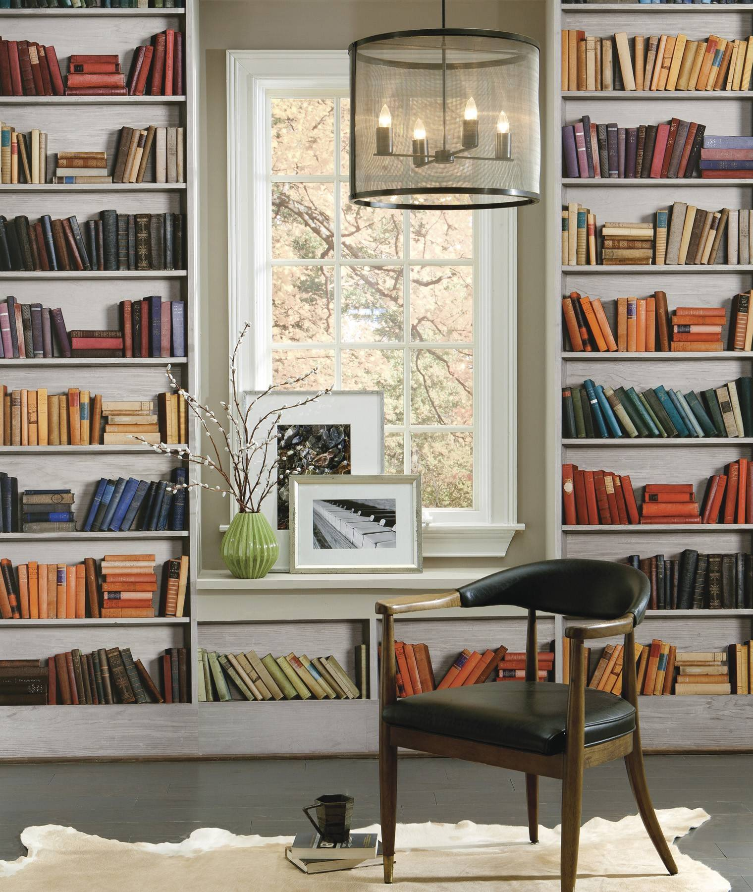 "Shhhh! This home ""library"" puts up a good front but hides a witty secret — it's all a charming fake."