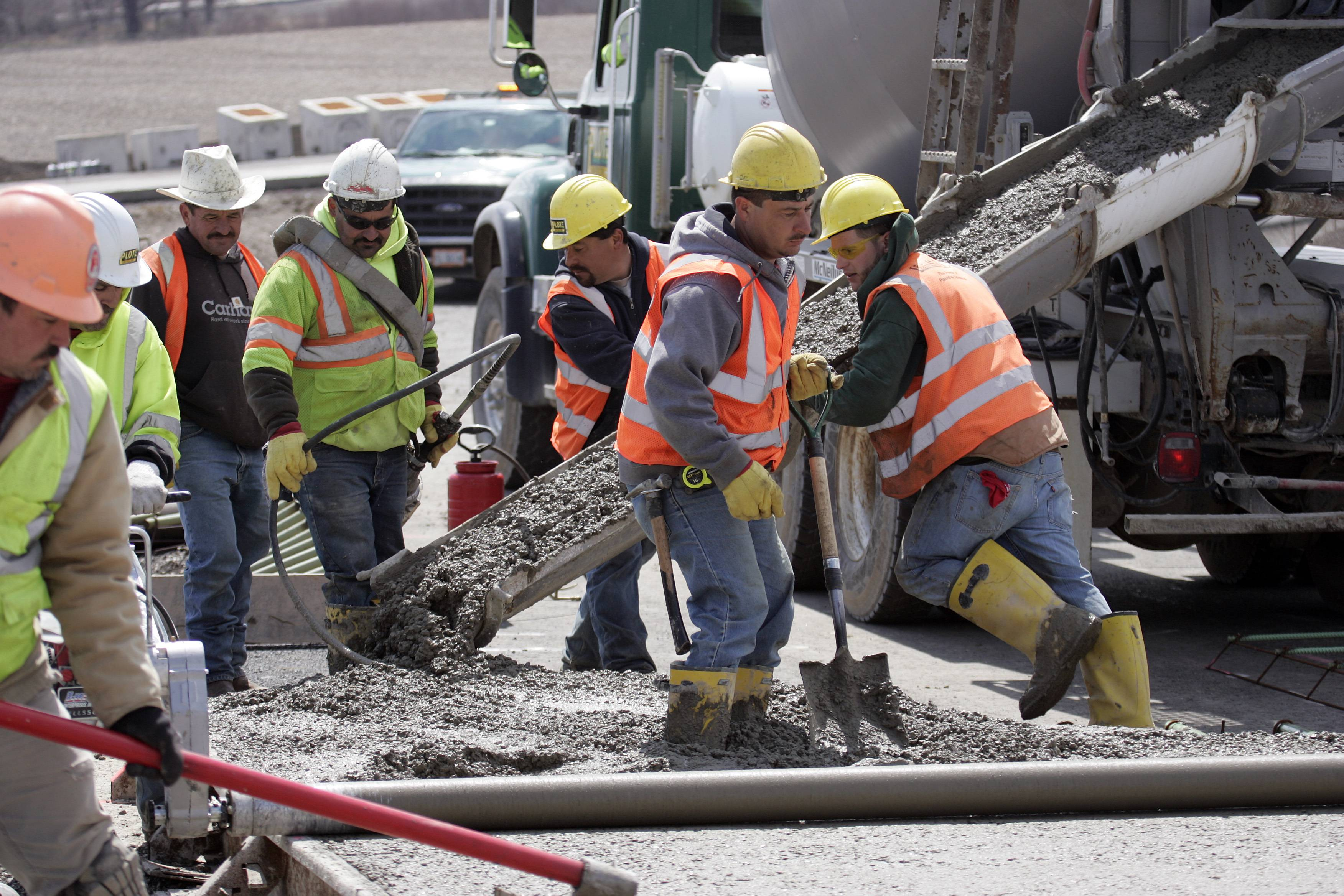 Workers pour concrete last year at Route 47 and I-90 in Huntley.