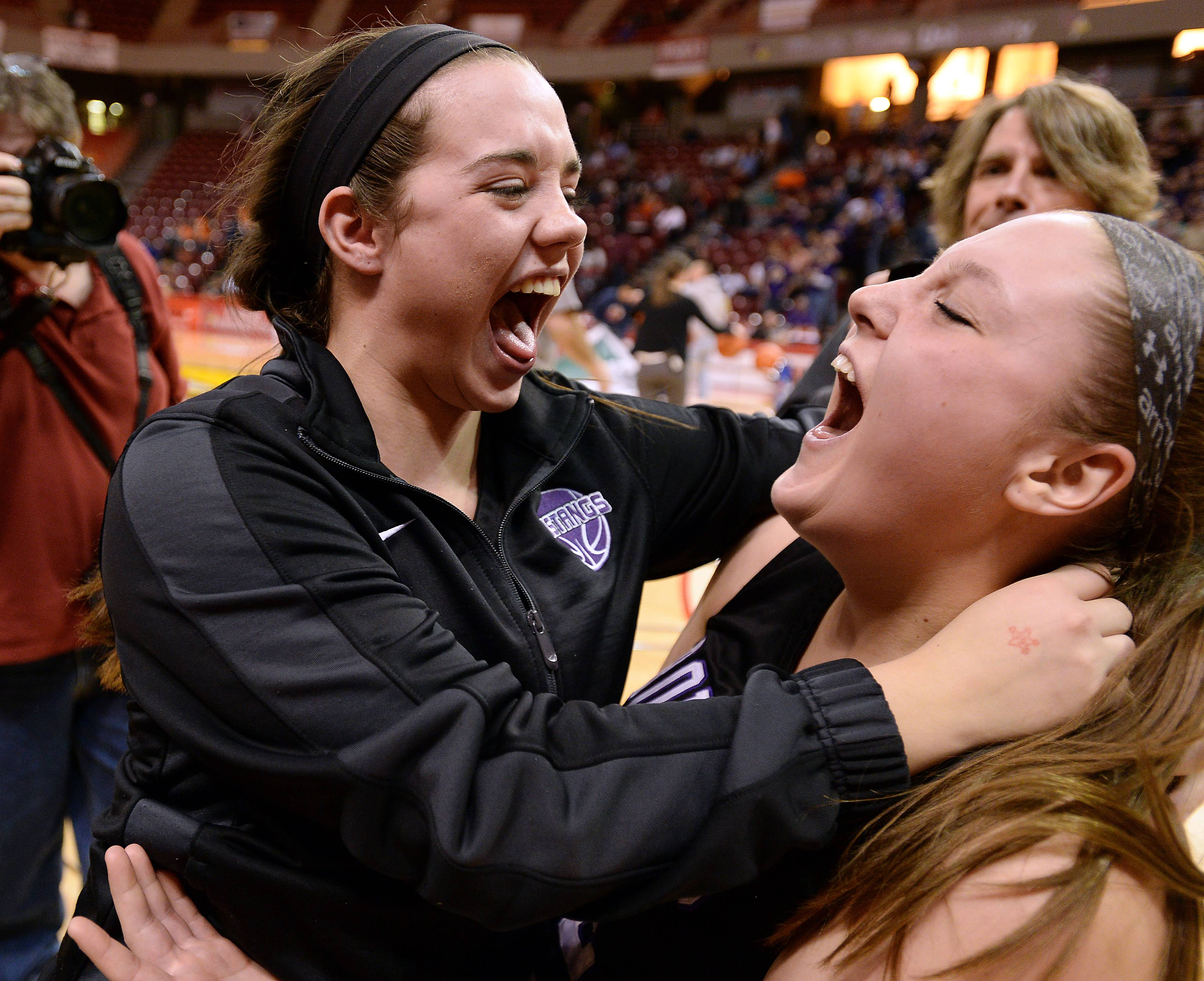 Mark Welsh/mwelsh@dailyherald.com Rolling Meadows' Jamie Berry celebrates with Katie Shewmon after the Mustangs topped Geneva in the Class 4A state semifinals in Normal on Friday.