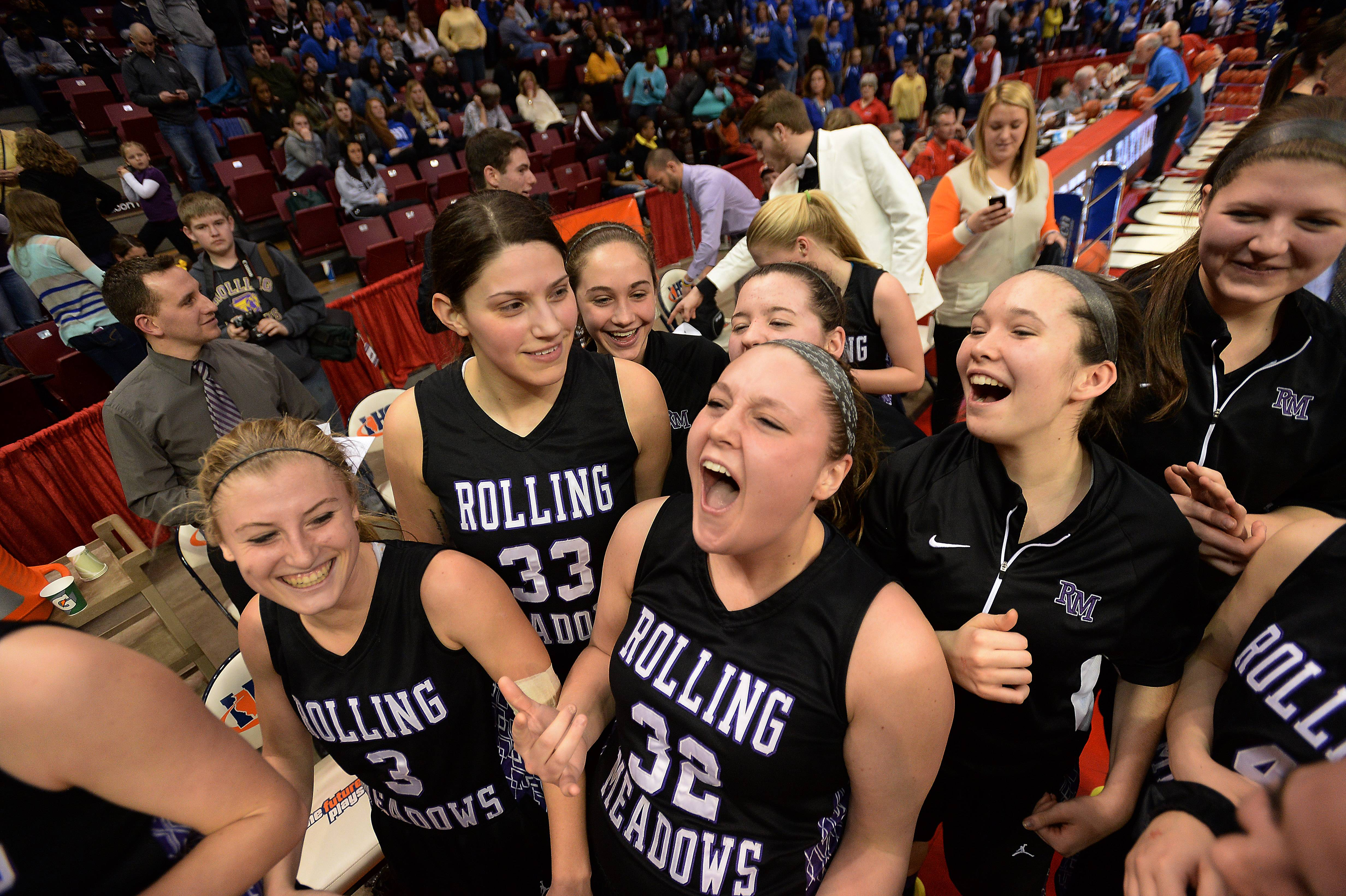 Rolling Meadows' Katie Shewmon celebrates with the rest of her teammates.