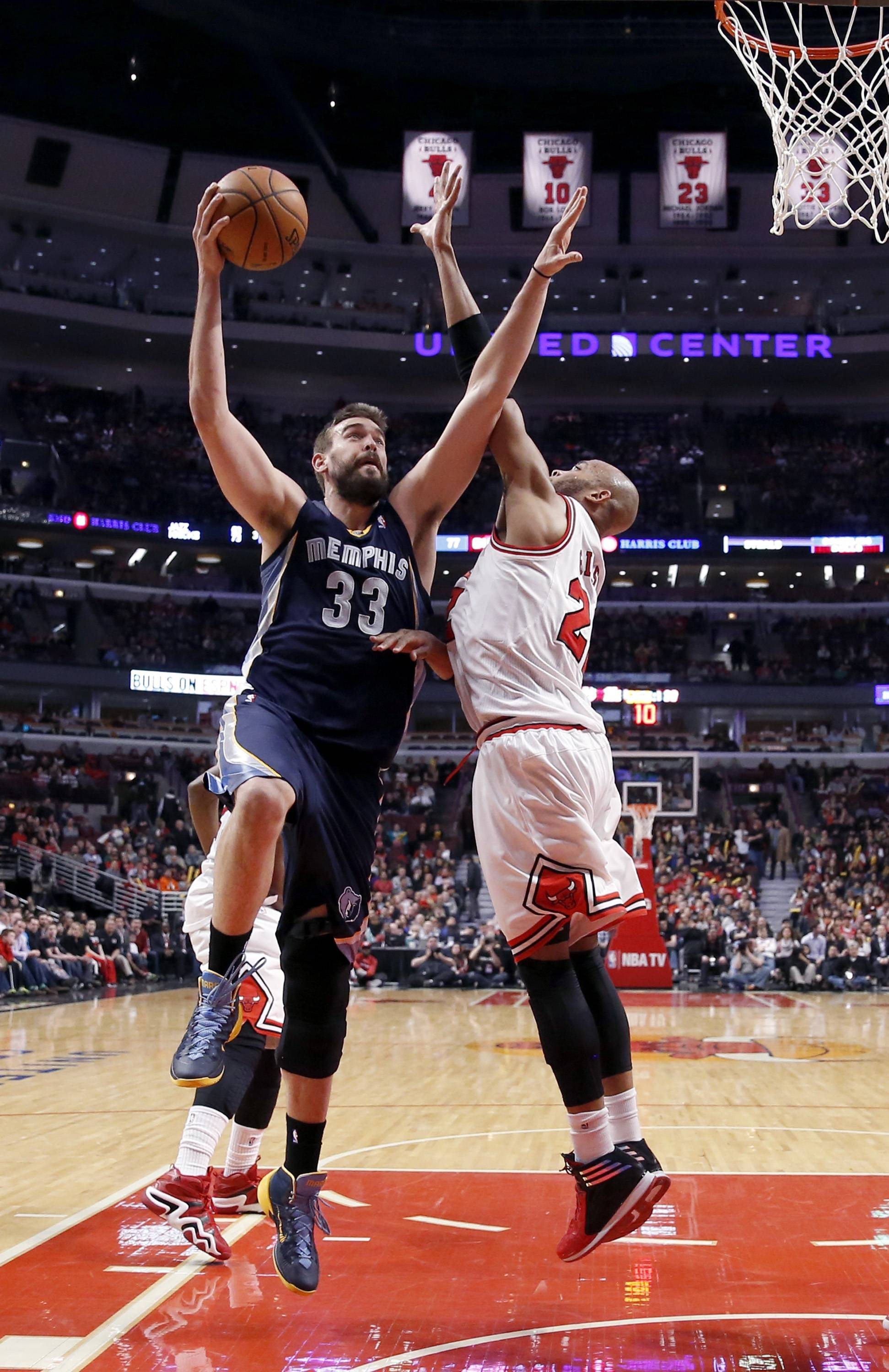 Memphis Grizzlies center Marc Gasol (33) shoots over Chicago Bulls' Taj Gibson (22) during the second half of an NBA basketball game on Friday, March 7, 2014, in Chicago. The Grizzlies won 85-77. (AP Photo/Charles Rex Arbogast)