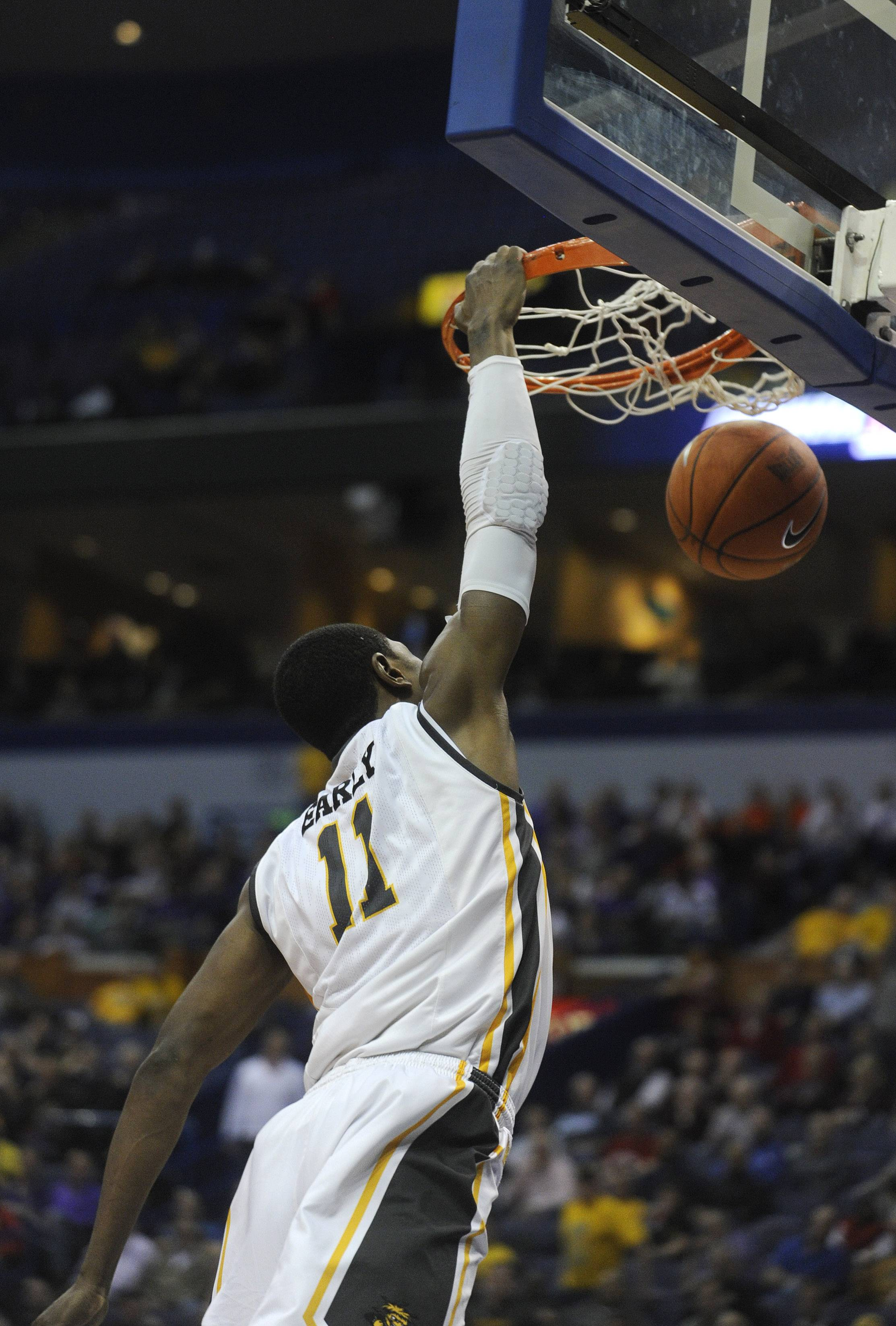 Wichita State's Cleanthony Early (11) dunks against Evansville in the second half of an NCAA college basketball game in the quarterfinals of the Missouri Valley Conference men's tournament, Friday, March 7, 2014 in St. Louis. (AP Photo/Bill Boyce)