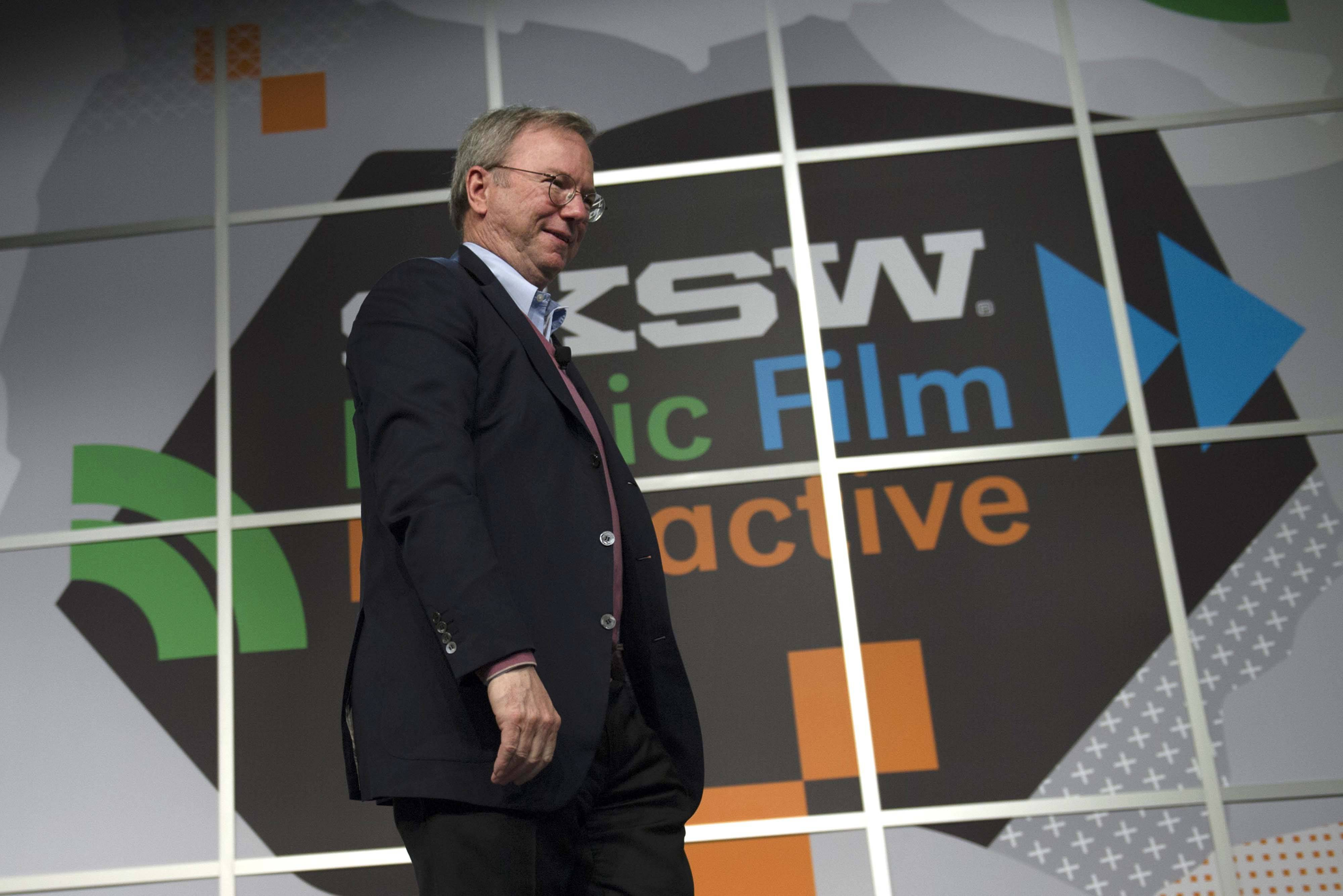 Eric Schmidt, executive chairman of Google Inc., exits after speaking Friday at the South By Southwest Interactive Festival in Austin, Texas.