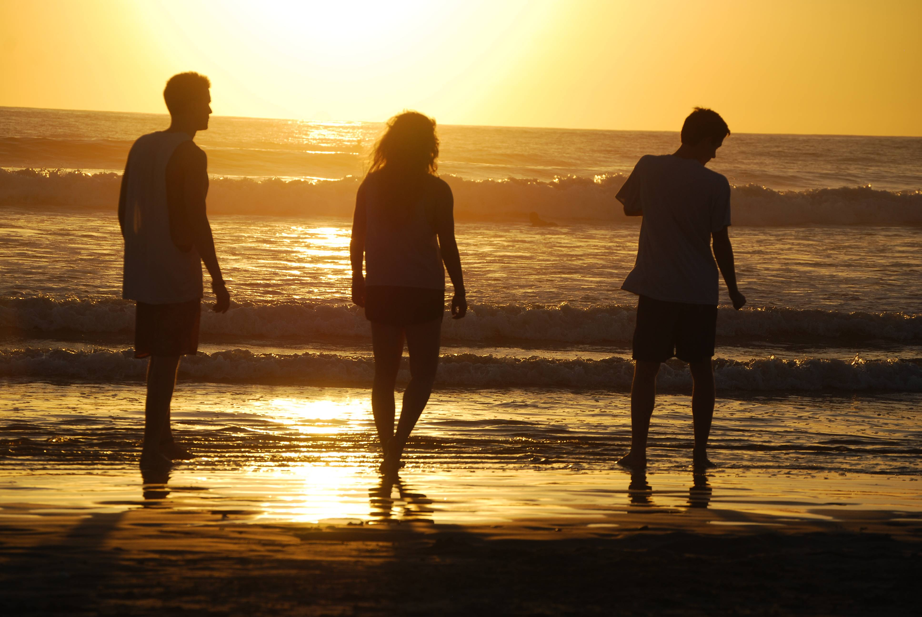 Liam Godfrey-Jolicoeur, left, Ruby Dombek and Jacob Dombek of N. Ferrisburg, Vt., soak in the sunset at Playa Guiones in Nosara, Costa Rica.