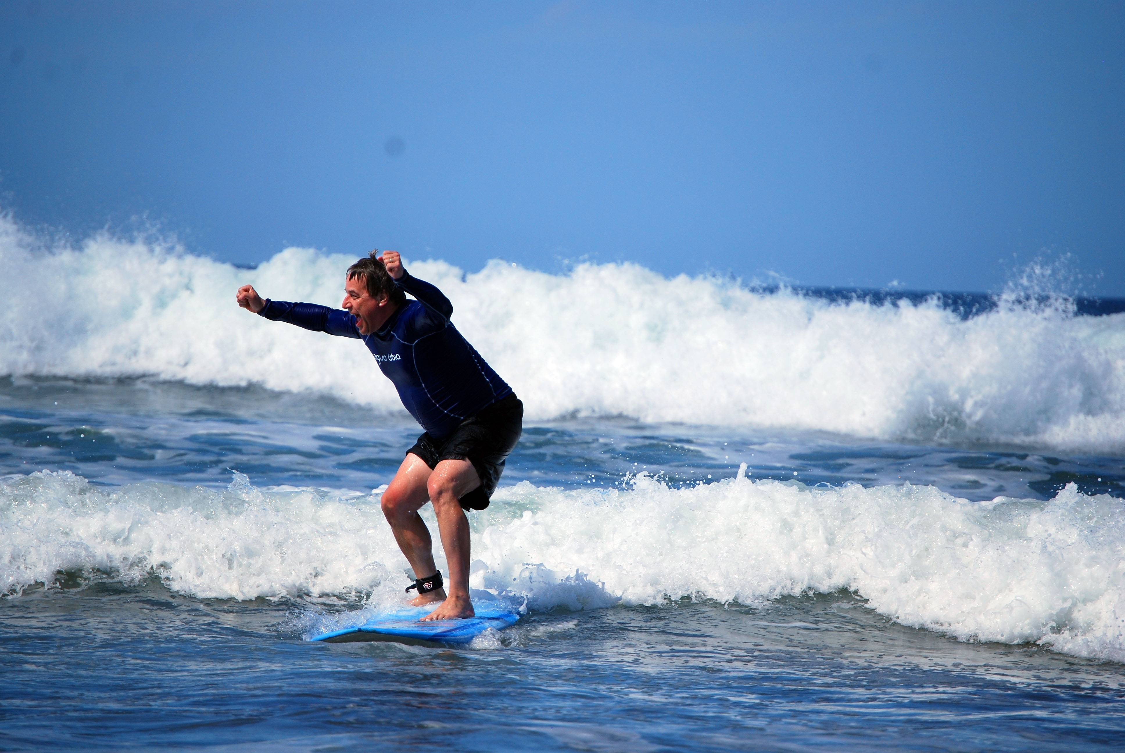 First-time surfer Andrew Dombek of N. Ferrisburg, Vt., rides the waves at Playa Guiones in Nosara, Costa Rica.