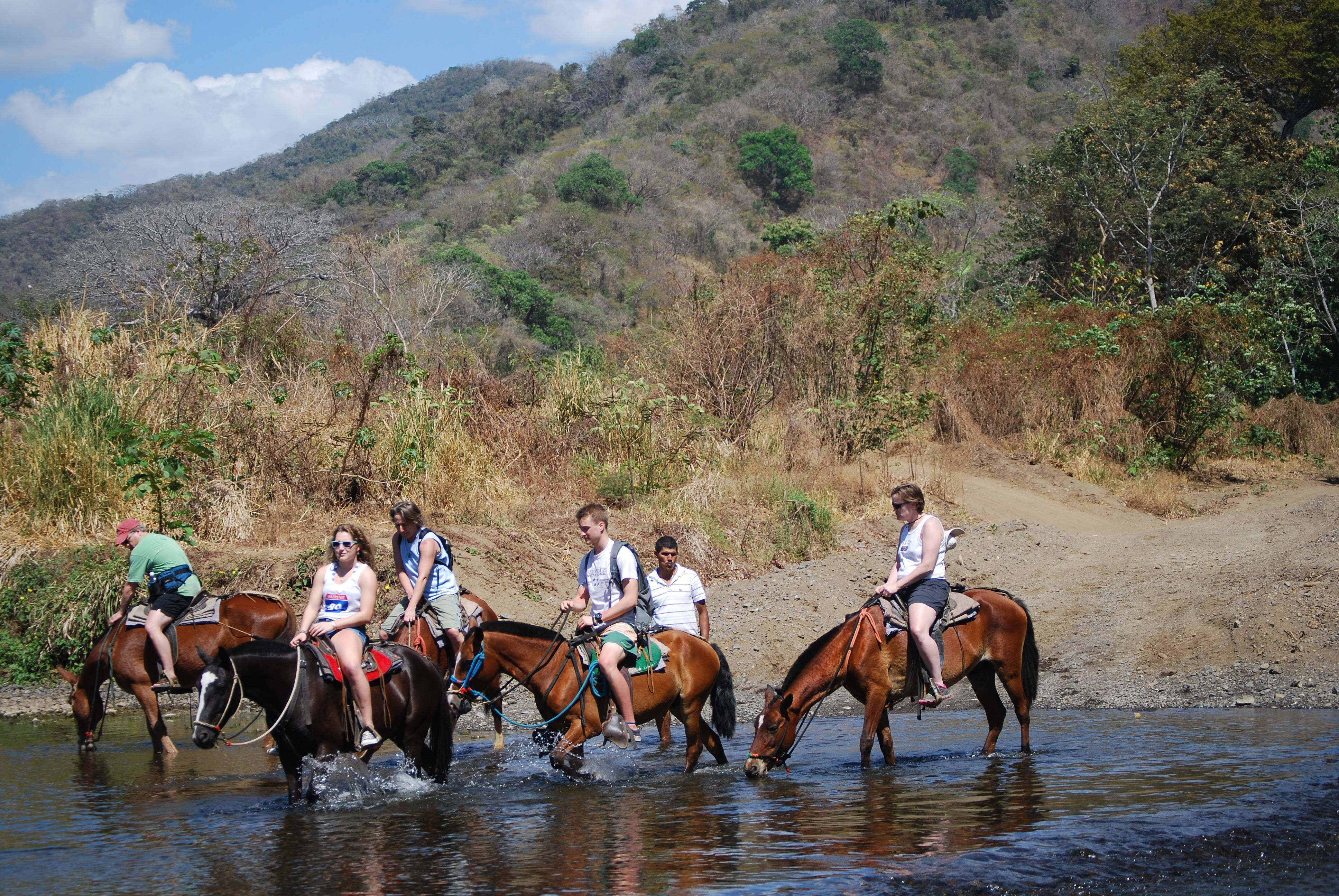 A group of horseback riders take a tour with outfitters Nosara Paradise Rentals in Nosara, Costa Rica.