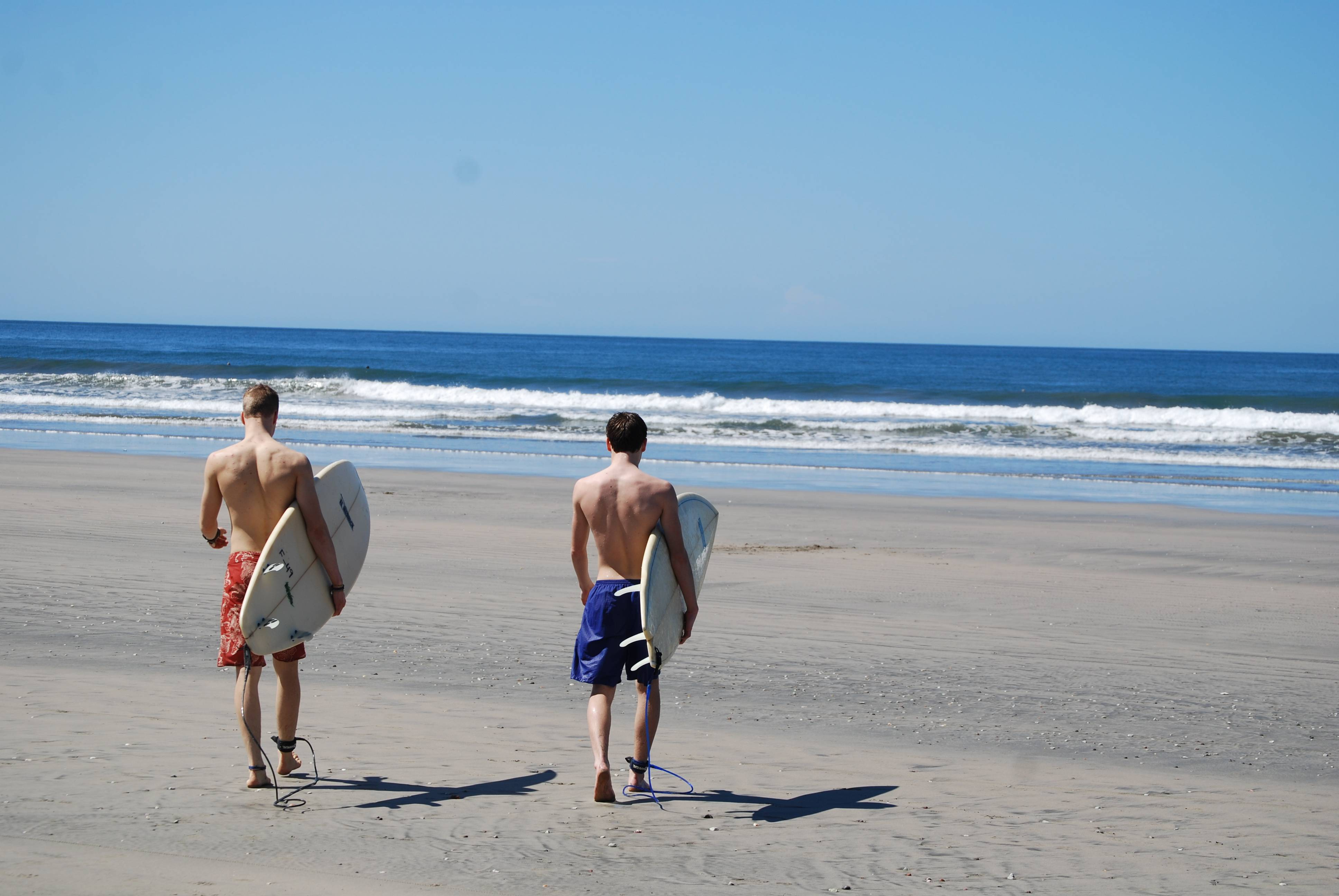 Liam Godfrey-Jolicoeur and Jacob Dombek, of N. Ferrisburg, Vt., head out to surf at Playa Guiones in Nosara, Costa Rica.