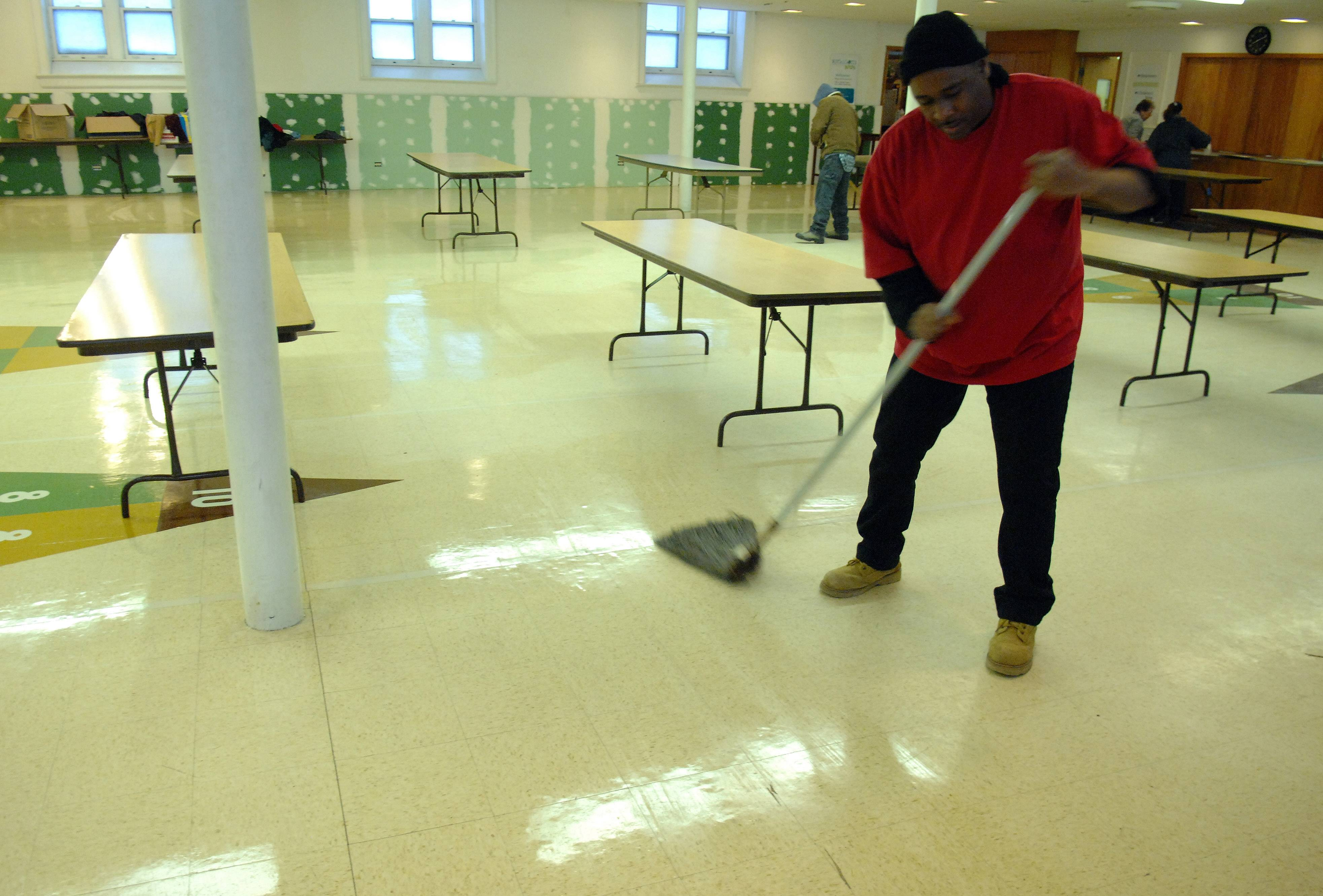 Hayes mops the floor after the breakfast ministry at Vineyard Church of Elgin.