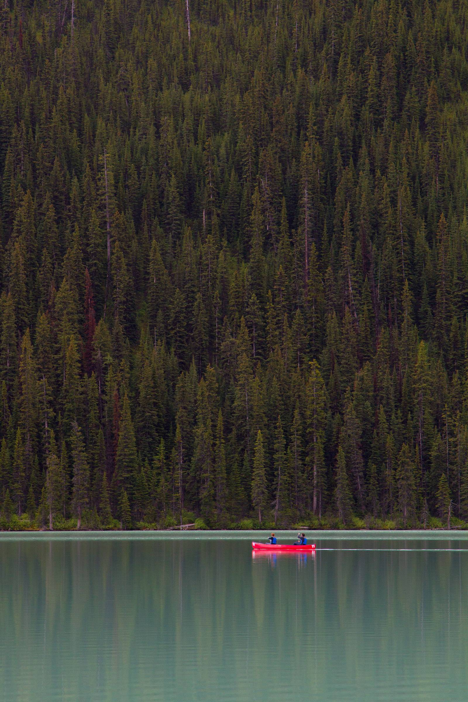 I took a motorcycle trip to Alaska last June and stopped at Lake Louise in Alberta, Canada on the way home. I took this picture near the end of a hiking trail that starts at Chateau Lake Louise and goes to the end of the lake. I really liked the image of the canoe crossing the vertical stand of trees on the far shore.