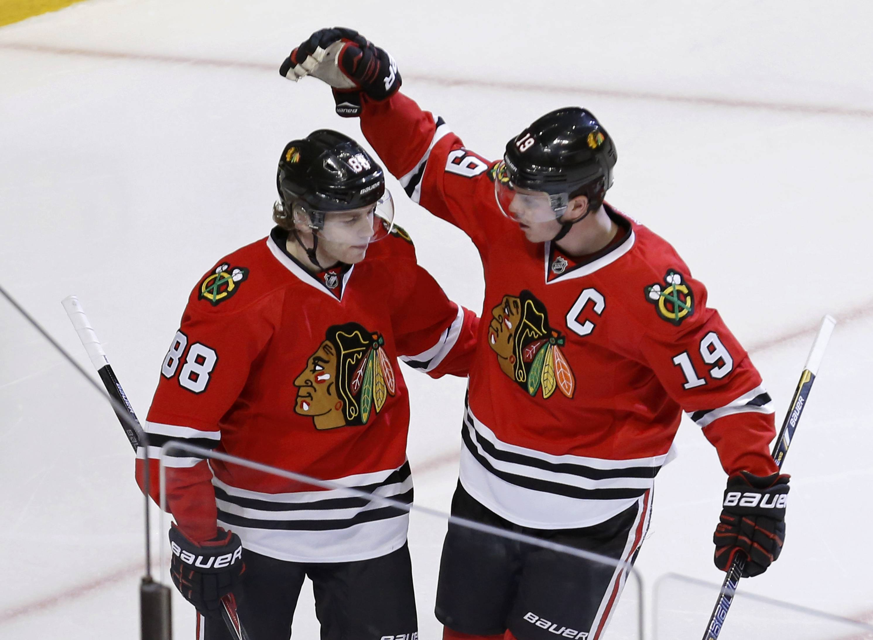 Captain Jonathan Toews celebrates his goal with Patrick Kane during the third period of the Hawks' 6-1 victory over the Blue Jackets at the United Center on Thursday.