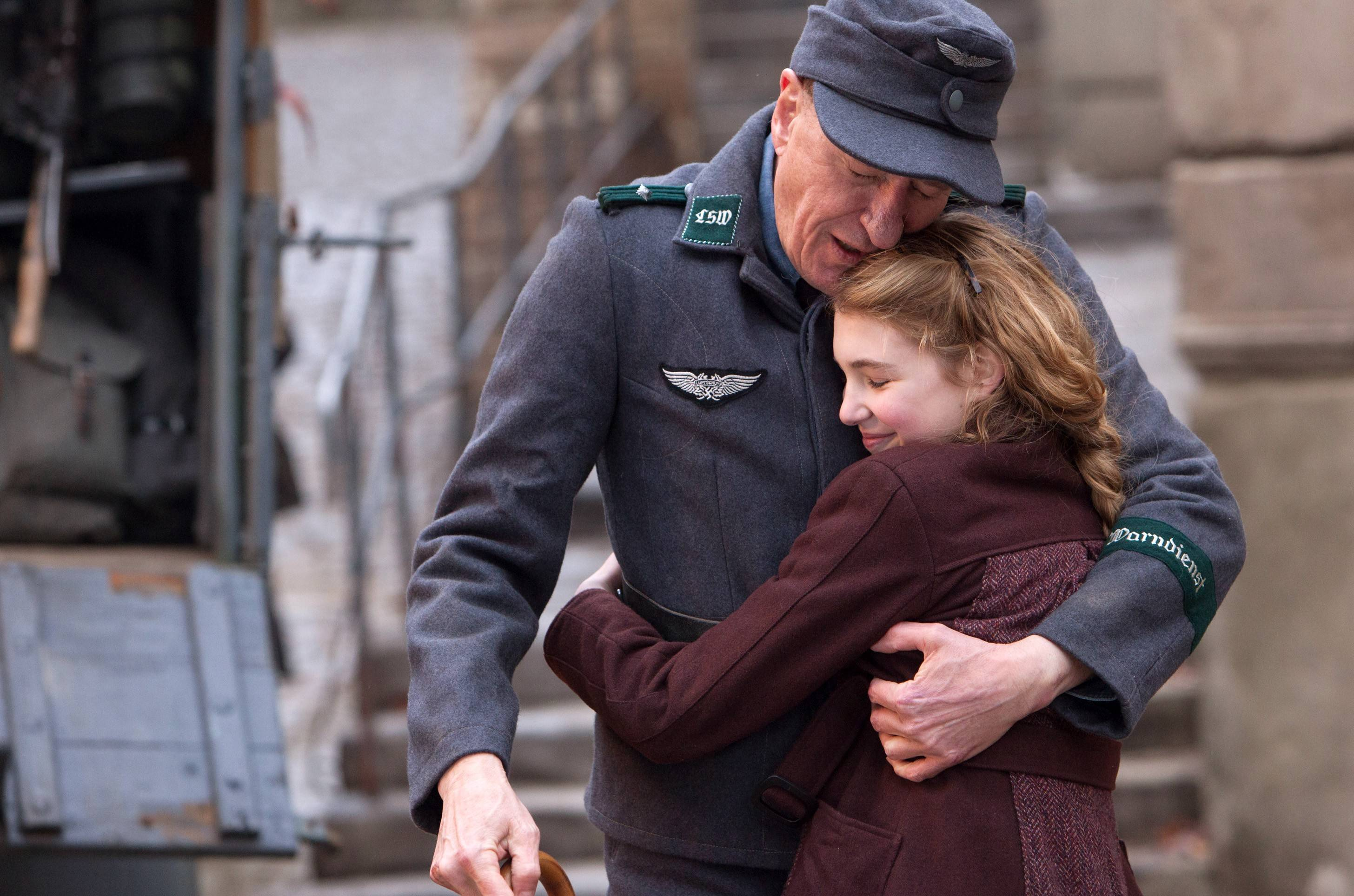 "Liesel (Sophie Nélisse) finds a home with Hans Hubermann (Geoffrey Rush) in Germany during World War II in ""The Book Thief."""