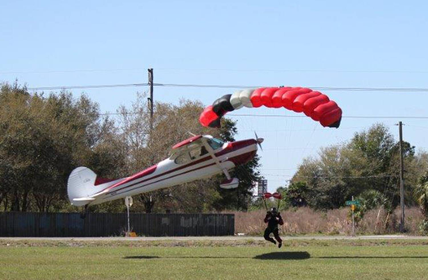 A plane gets tangled Saturday with a parachutist, at the South Lakeland Airport in Mulberry, Fla. Both the pilot and jumper hospitalized with minor injuries.