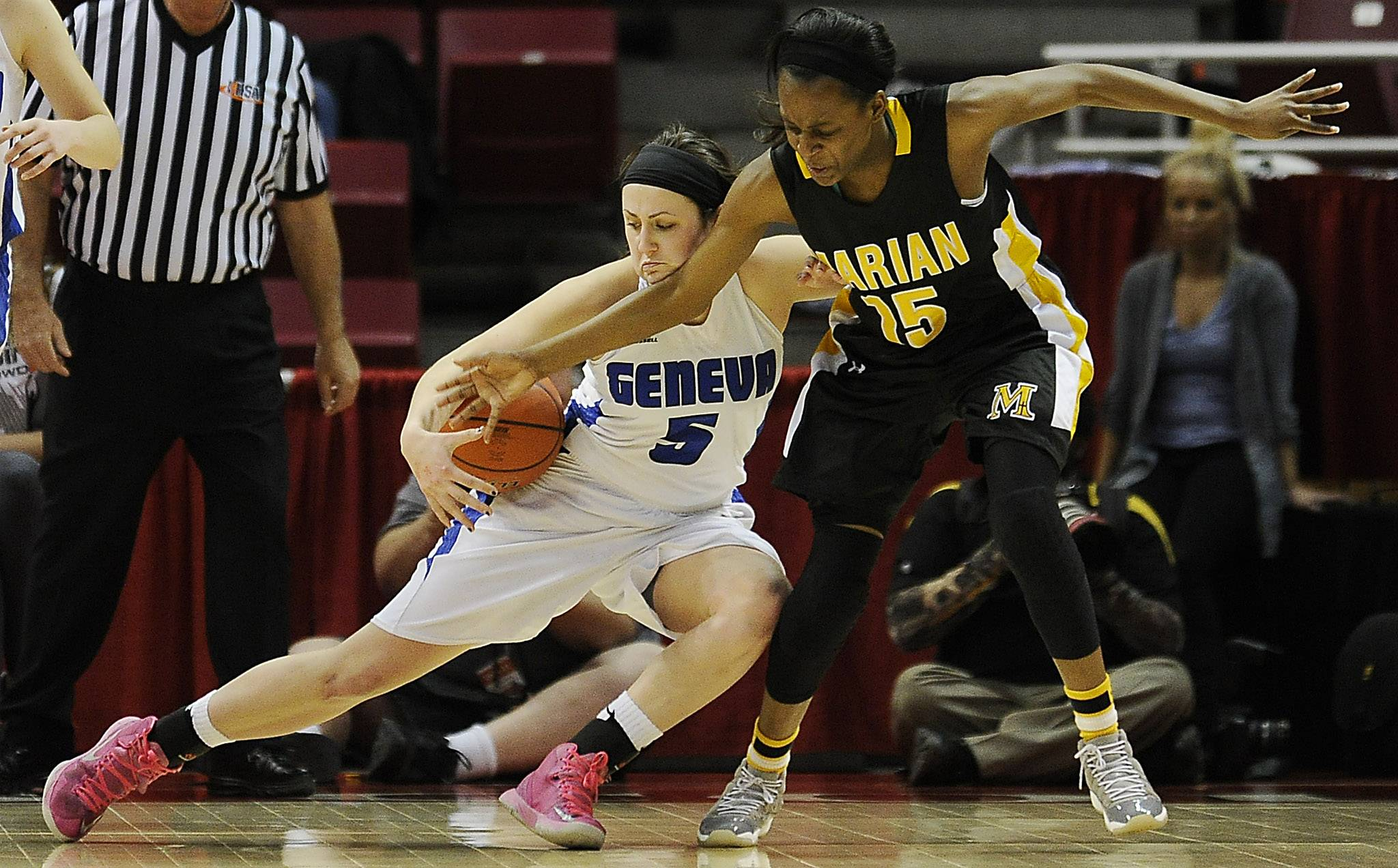 Geneva's Abby Novak battles Marian Catholic's Gabrielle Cooper for a possession in the second half of the Class 4A third-place game in Normal on Saturday.