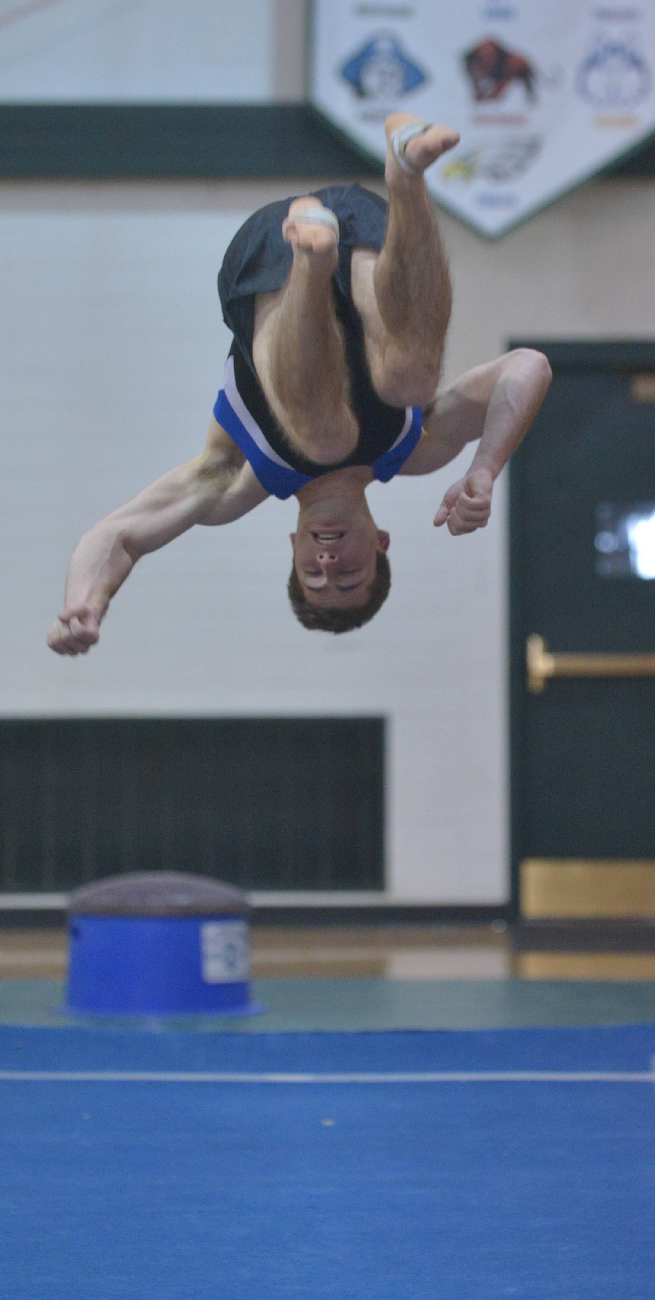 Dave McDonald of Wheaton co-op on the floor during the Glenbard West boys gymnastics quad Saturday.