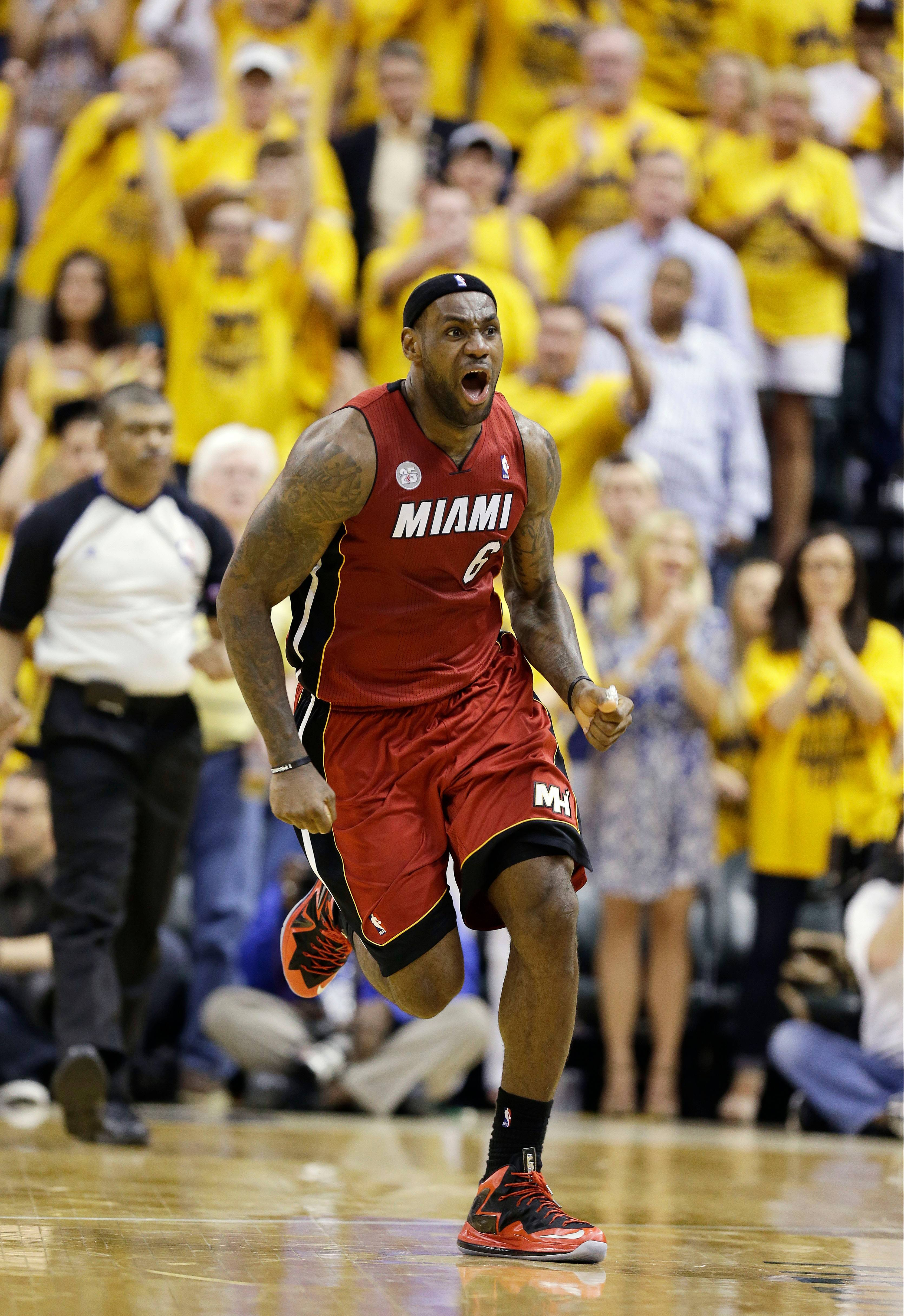 Miami Heat forward LeBron James reacts after being called for a technical foul while shooting against the Indiana Pacers during the second half of Game 6 of the NBA Eastern Conference basketball finals in Indianapolis, Saturday, June 1, 2013.
