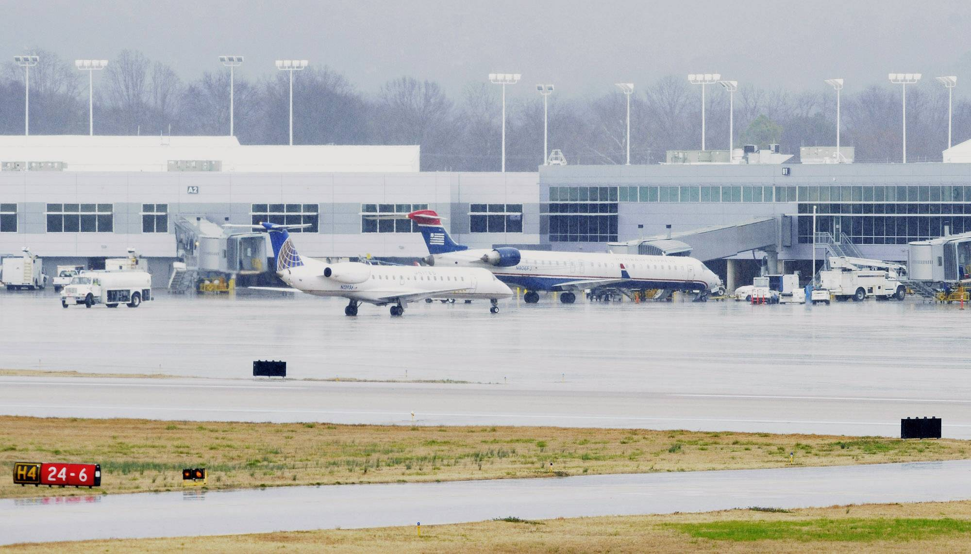A United Express jet operated by ExpressJet pulls into the terminal Thursday after landing in rain on the main runway at Birmingham-Shuttlesworth International Airport in Birmingham, Ala.