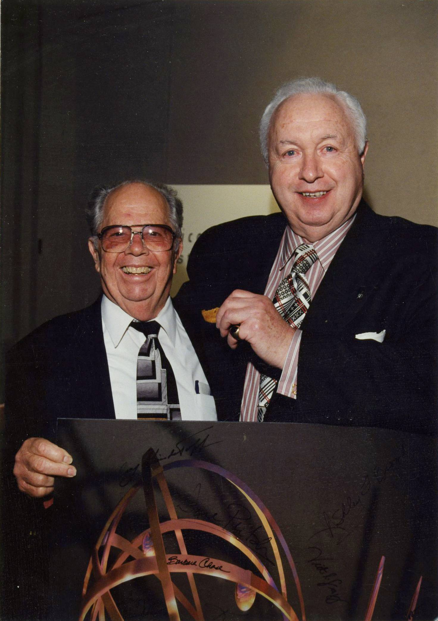 "Academy of Television Arts and Sciences shows Henry ""Hank"" Rieger, left, with Tom Sarnoff, former presidents of the Television Academy, at Rieger's retirement ceremony in 1999 in Los Angeles."
