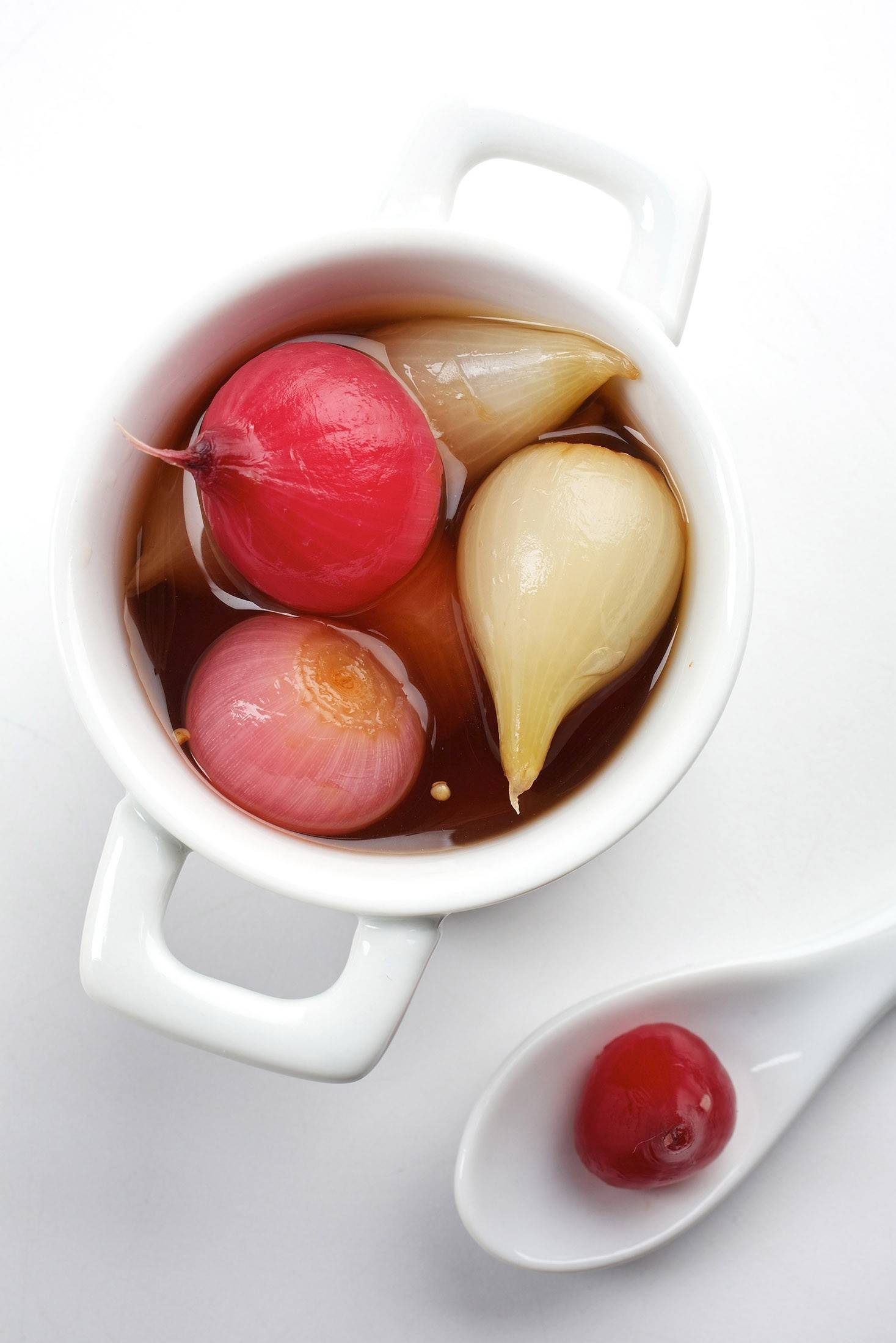 The pickled onion gives the Gibson its salty, sour bite.