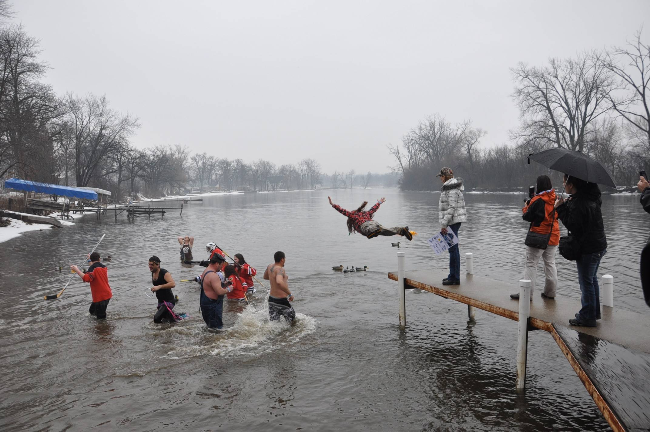 The Fox River Shiver features costumed divers for chairity at Broken Oar Beach in Port Barrington on Sunday, March 9.