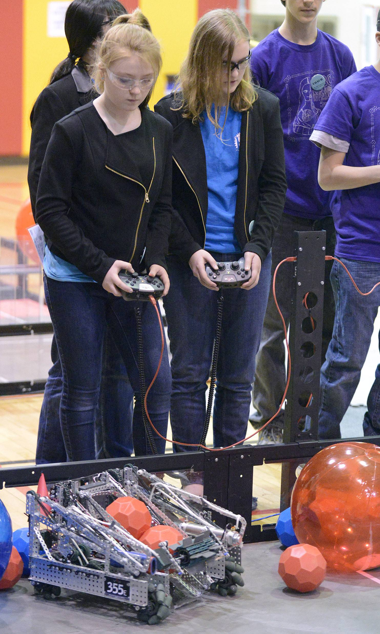 Gabby Garbaccio, left, and Katie Miller, both 14 and from Batavia, work together as their robot from team Cobalt competes in a first-round match in the Illinois VEX Robotics state championships Saturday in Batavia. The team was 2012 VEX National Champions as well as the 2012 VEX World Champions.