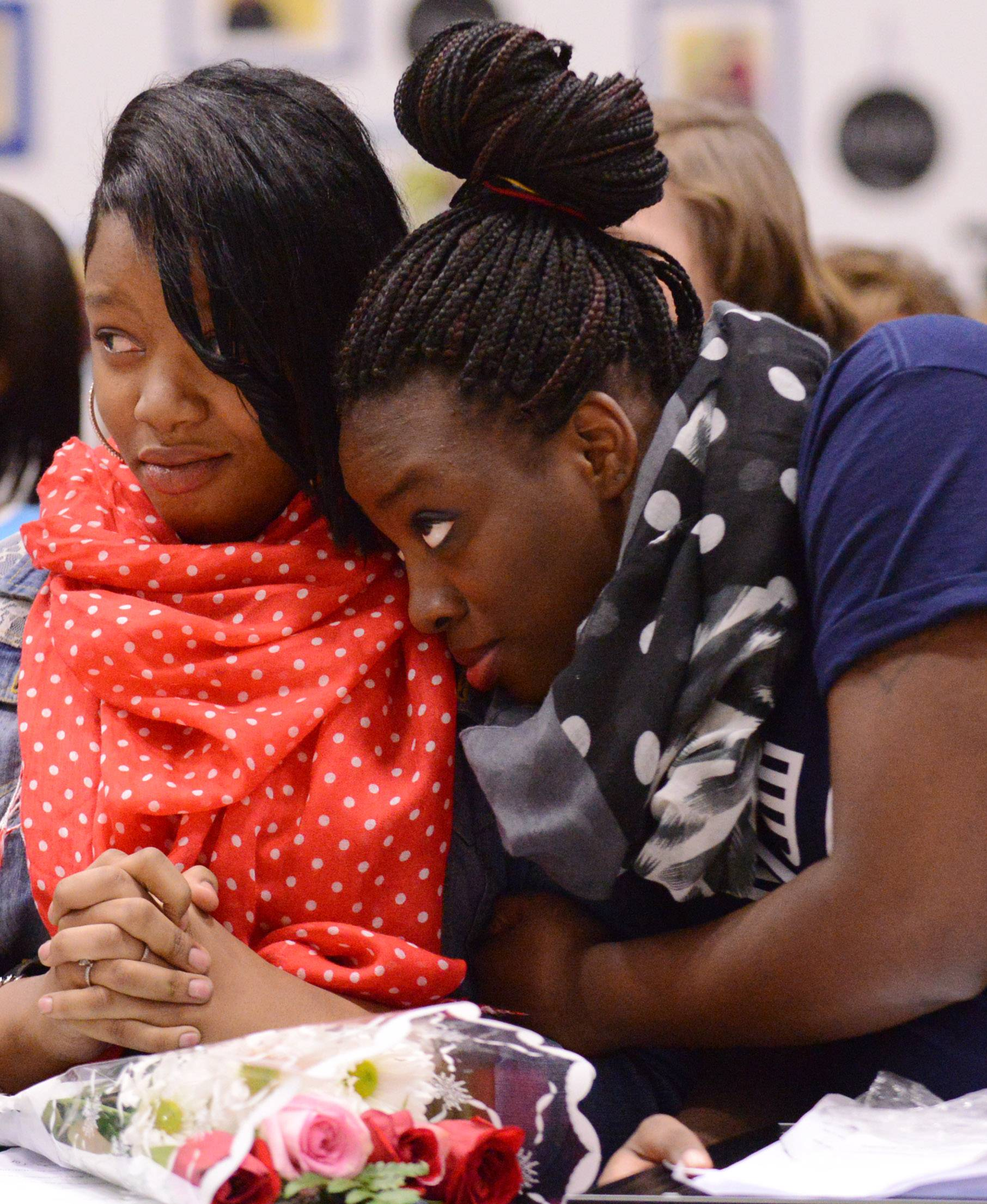 Anastaza Hicks, left, and Jhaneice Johnson wait to hear who will be selected Youth of the Year earlier this week by the Boys & Girls Club of Elgin. Hicks is a freshman and Johnson a senior at Larkin High School.