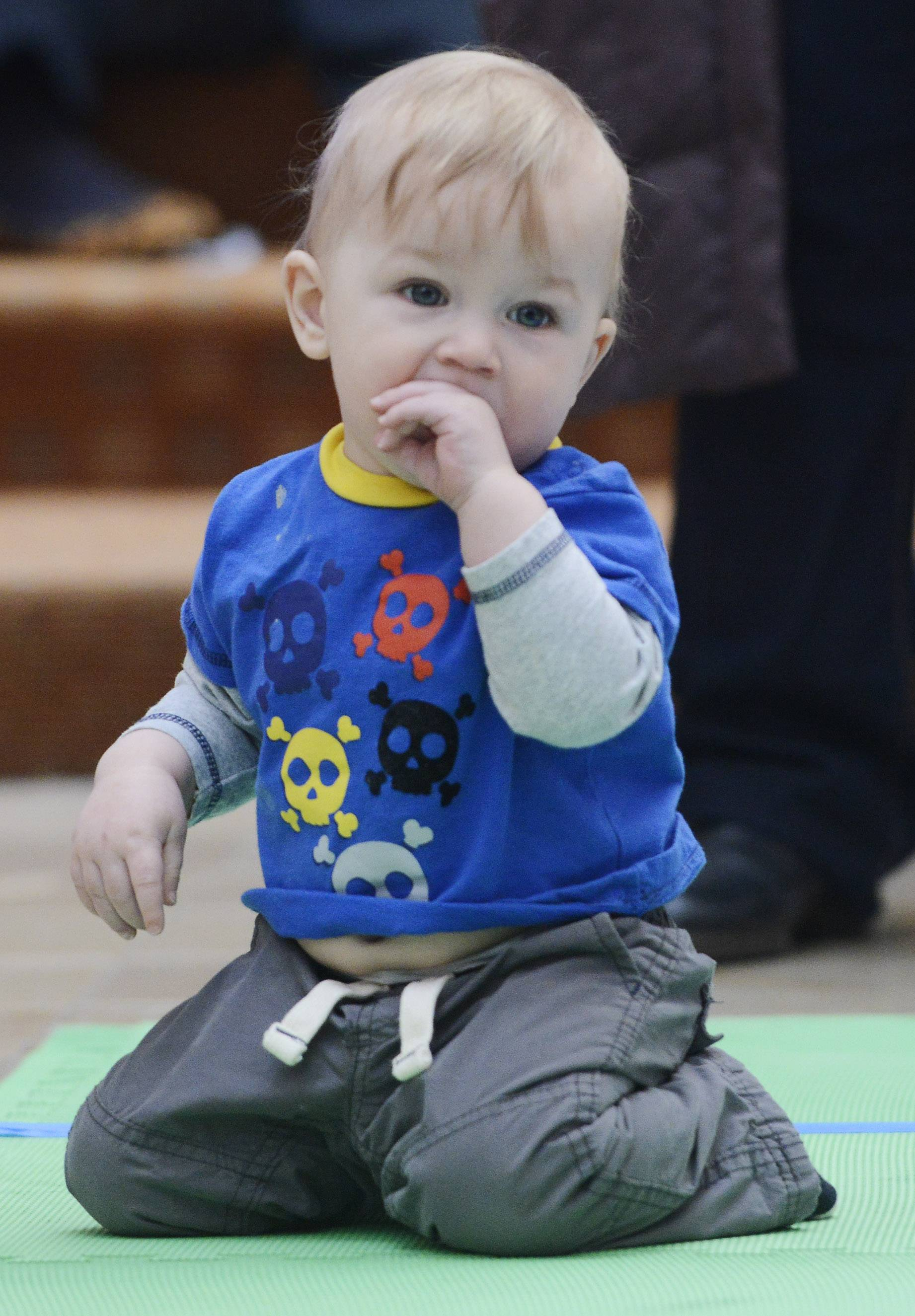 Tristan Potkanski of Chicago, a day shy of his first birthday, didn't quite muster the competitive spirit for the Diaper Derby event Saturday at Woodfield Mall in Schaumburg.