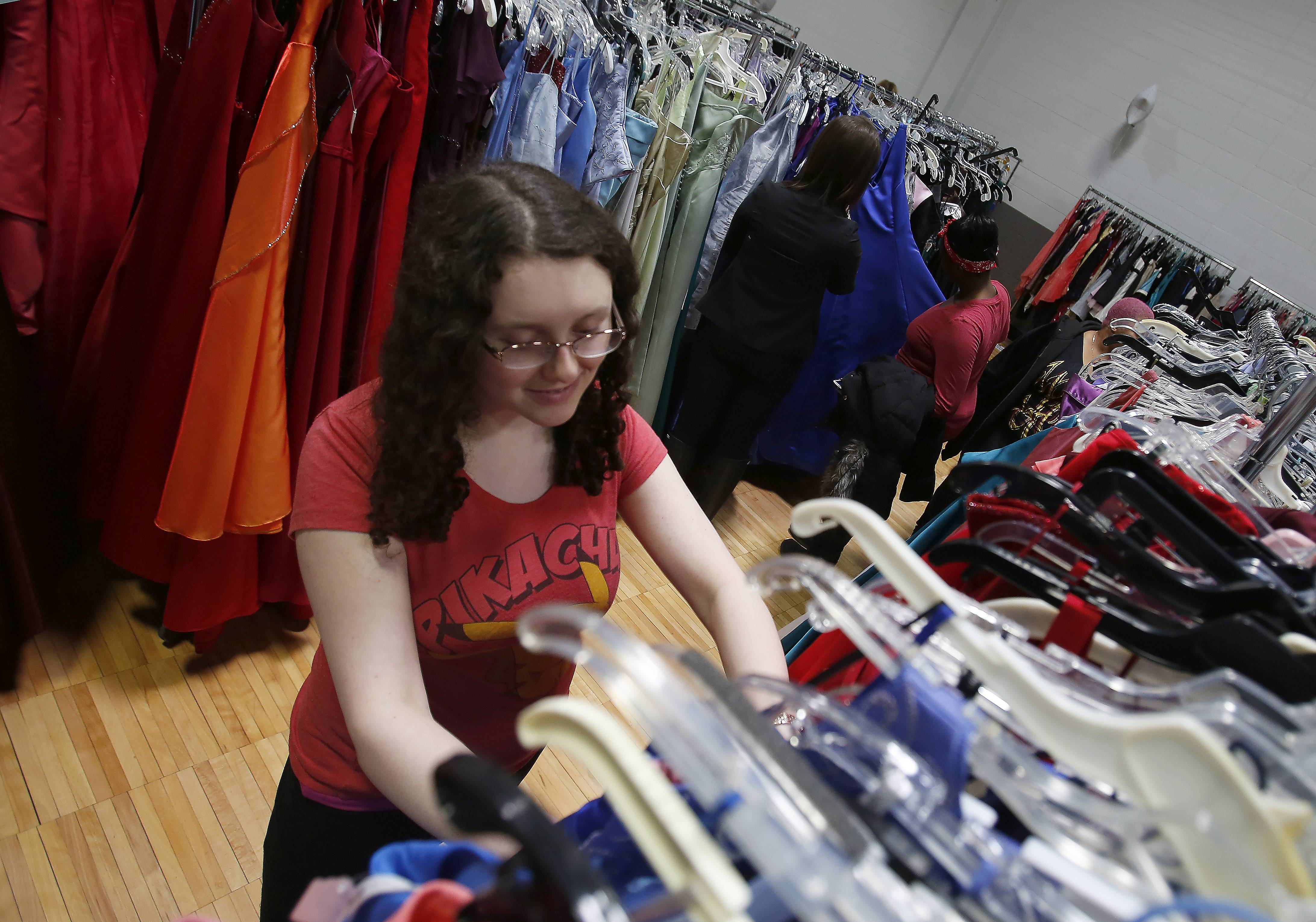 Katherine Winston, 16, of Naperville looks over some of the dresses during the annual Cinderella's Closet event Saturday the YWCA in Elgin.