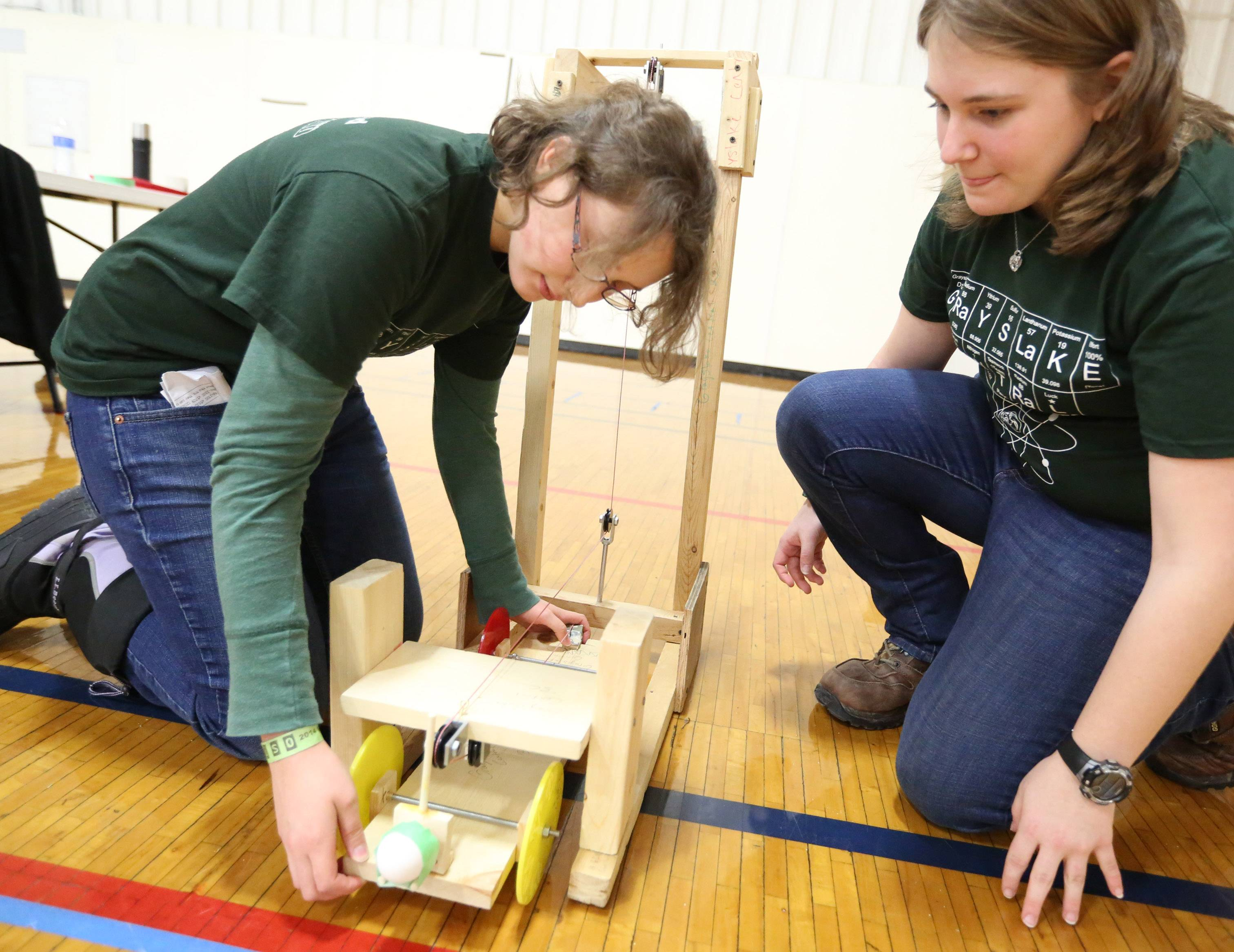 Grayslake Central High School students Kayla Penkava and Jaclyn Farm prepare their scrambler egg car for take off during the Grayslake Regional Science Olympiad on Saturday at College of Lake County. About 900 middle and high school students participated.