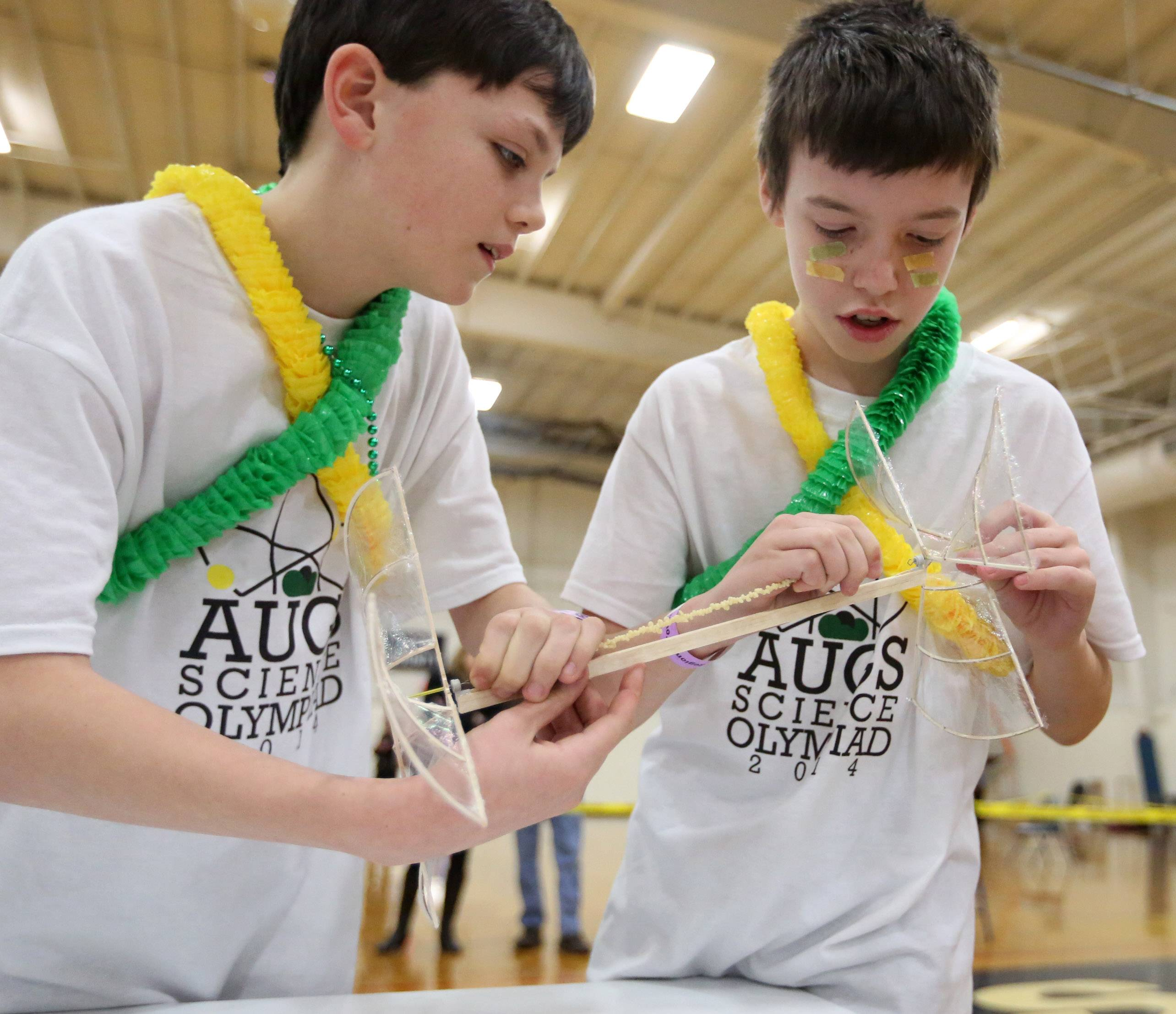 Antioch Upper Grade School students Christopher Penn, left, and Josh Linck prepare their helicopter to compete in the Grayslake Regional Science Olympiad on Saturday at College of Lake County. About 900 students competed.