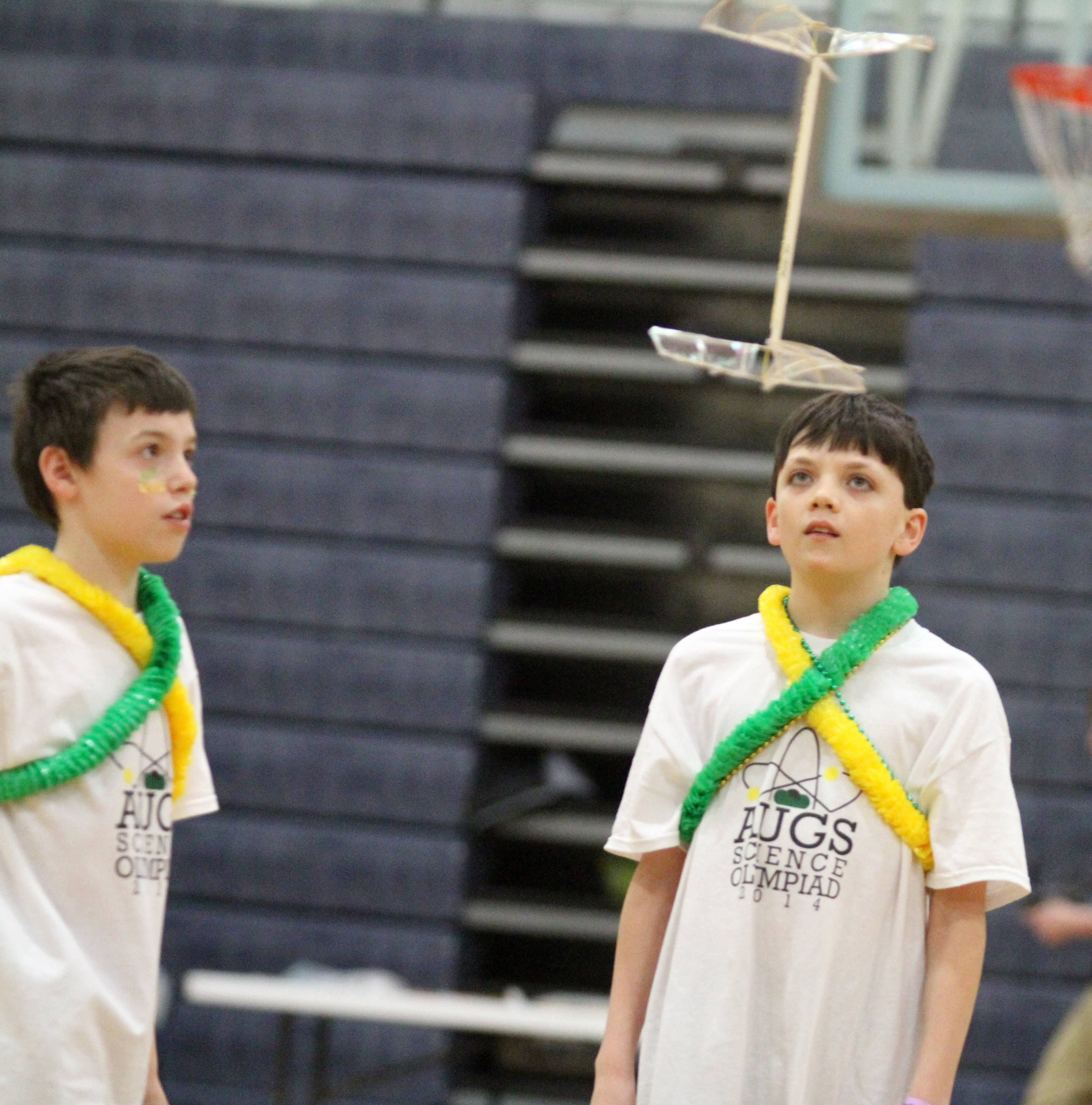 Antioch Upper Grade School students Josh Linck, left, and Christopher Penn watch their helicopter compete in the Grayslake Regional Science Olympiad on Saturday at College of Lake County. Teams vied for spots at the state competition in April.