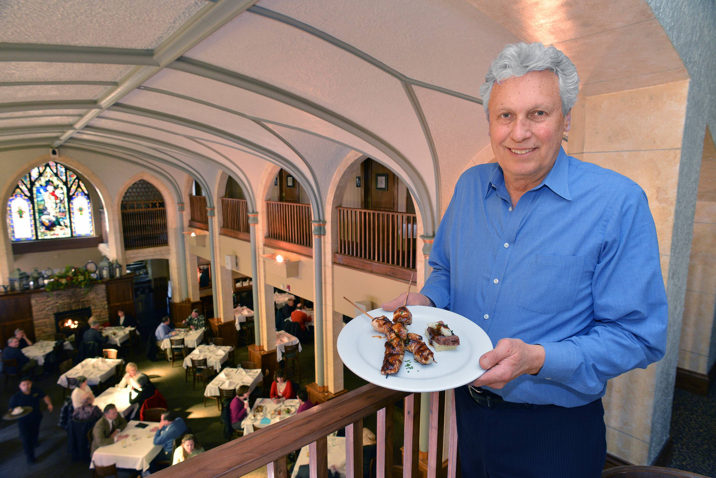 Dick O'Gorman, owner of the Ivy restaurant in downtown Wheaton, displays two specials -- chicken satay skewers and andouille sausage meatloaf canap�s -- that he'll be offering during a kickoff event for the Downtown Wheaton Association's first Restaurant Week.