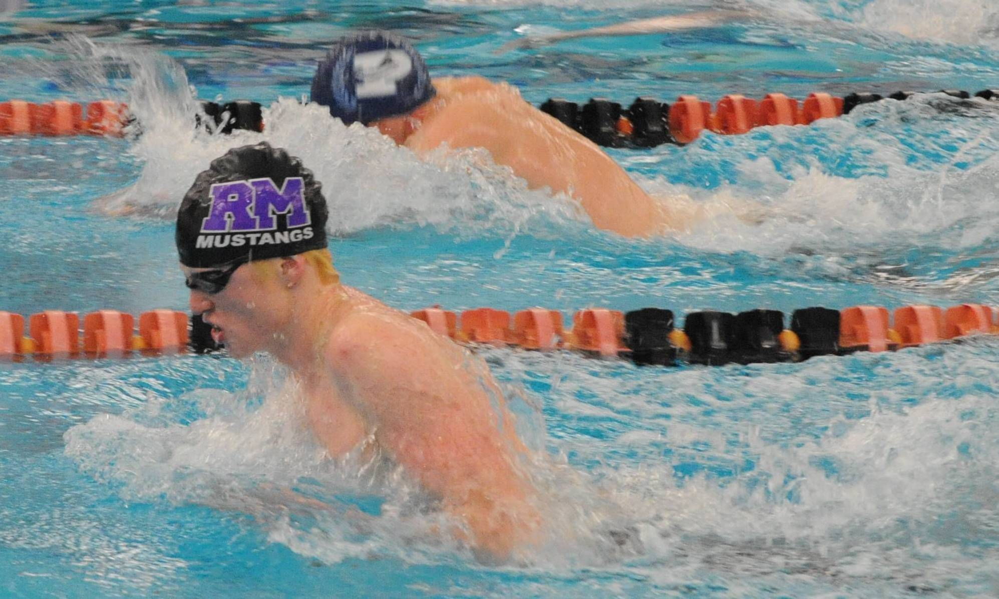 Rolling Meadows' Jake Barson, foreground, and Prospect's Nathanael Ginnodo race to a 1-2 finish in the 100-yard breaststroke in the MSL meet. Barson was named MSL East co-swimmer of the year.