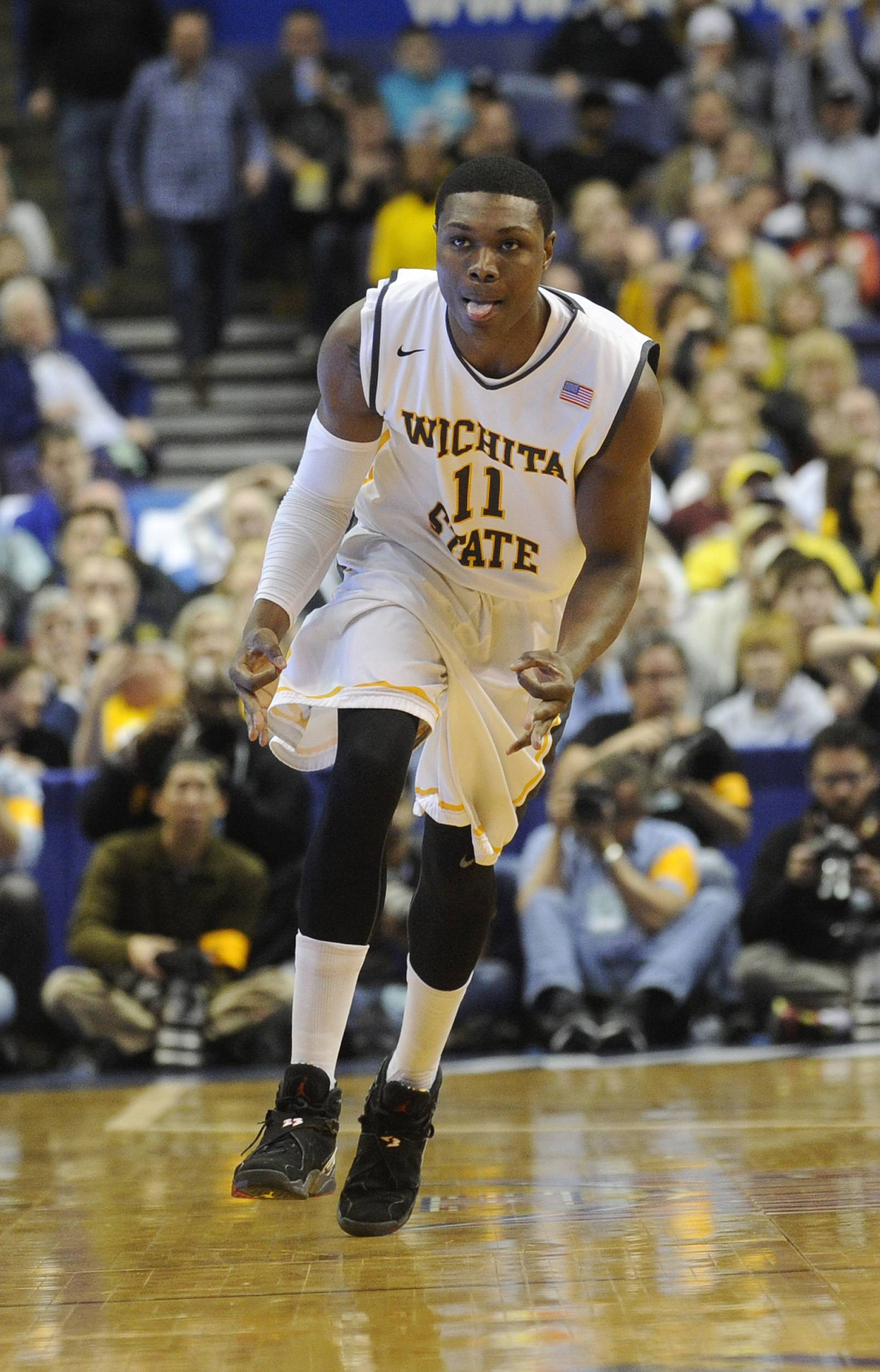 Wichita State's Cleanthony Early (11) celebrates a basket against Missouri State during a game in the semifinals of the Missouri Valley Conference men's tournament Saturday in St. Louis.