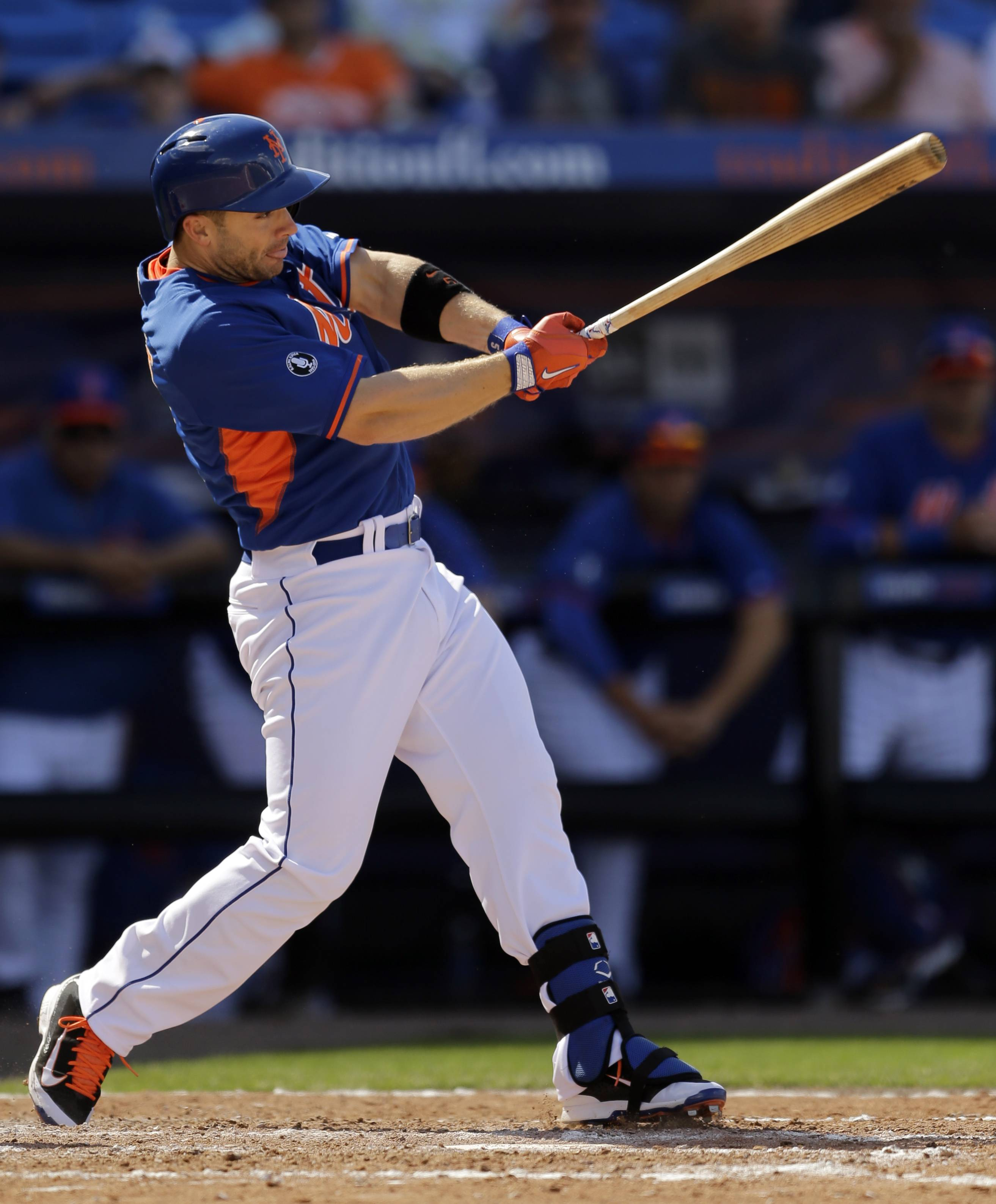 New York Mets' David Wright grounds into a double play during the fourth inning of an exhibition spring training baseball game against the St. Louis Cardinals, Friday, March 7, 2014, in Port St. Lucie, Fla.