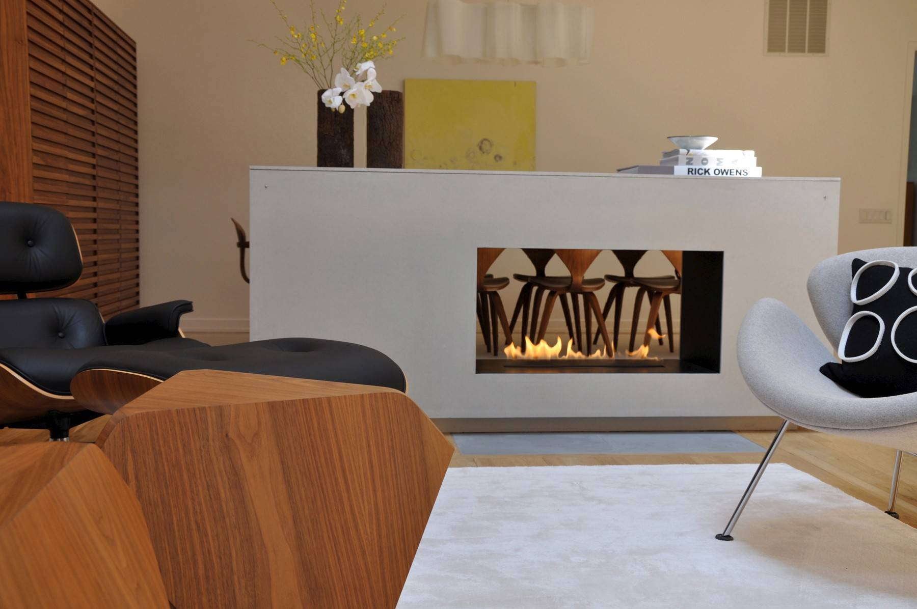 With new elements available on the market today, we can make a simple cabinet function like the fireplace of yore.
