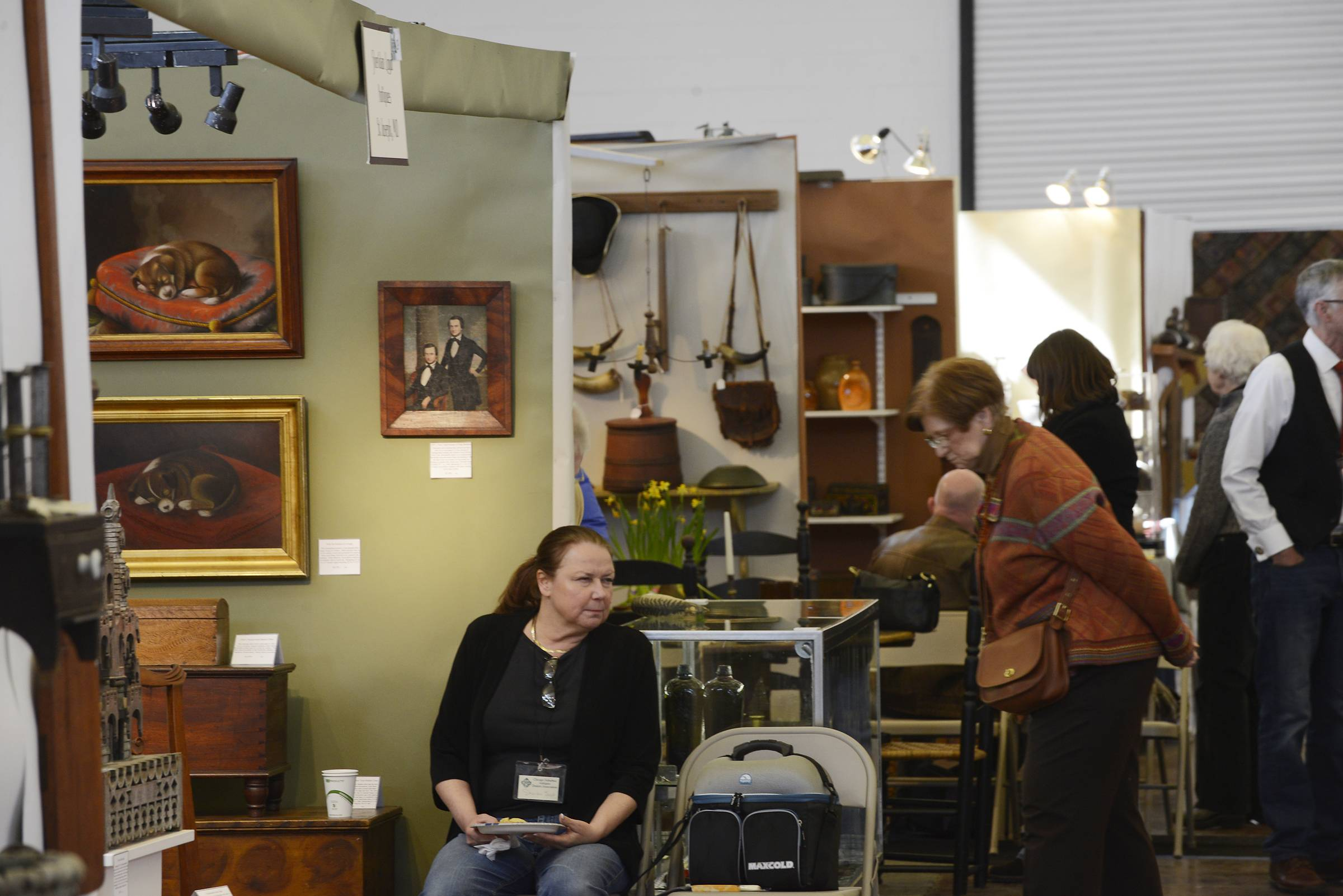 Antiques shoppers take their time to visit the 55 booths at the 57th Fox Valley Antiques Show on Sunday at the Kane County Fairgrounds in St. Charles. The show benefitted the Garfield Farm and Museum in St. Charles.