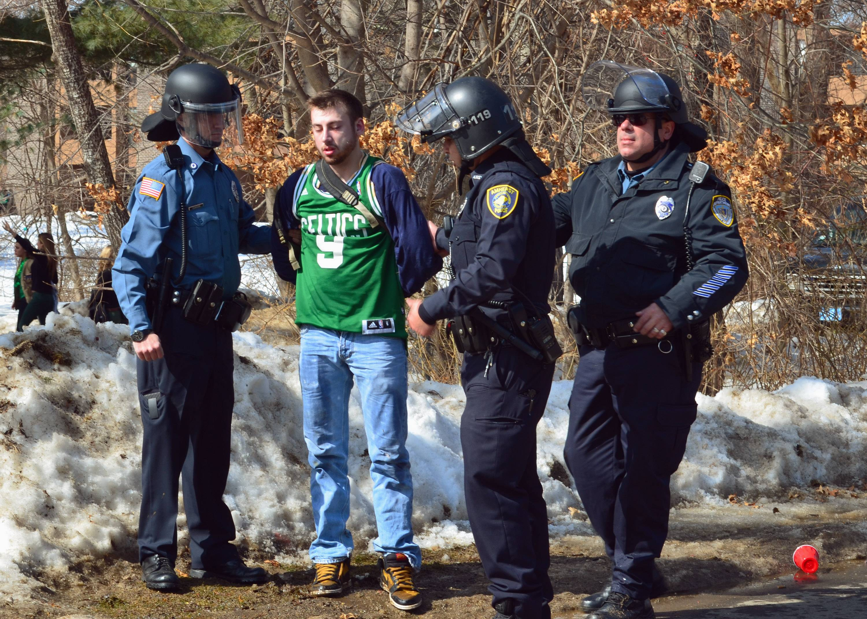 "Police detain a participant Saturday in the pre-St. Patrick's Day ""Blarney Blowout"" near the University of Massachusetts in Amherst, Mass. Amherst police said early Sunday that 73 people had been arrested after authorities spent most of the day Saturday attempting to disperse several large gathering around the UMass campus for the party traditionally held the Saturday before spring break. The partying carried through Saturday evening into early Sunday, and Amherst Police Capt. Jennifer Gundersen said in a statement that police were busy with numerous reports of fights, noise and highly intoxicated individuals."