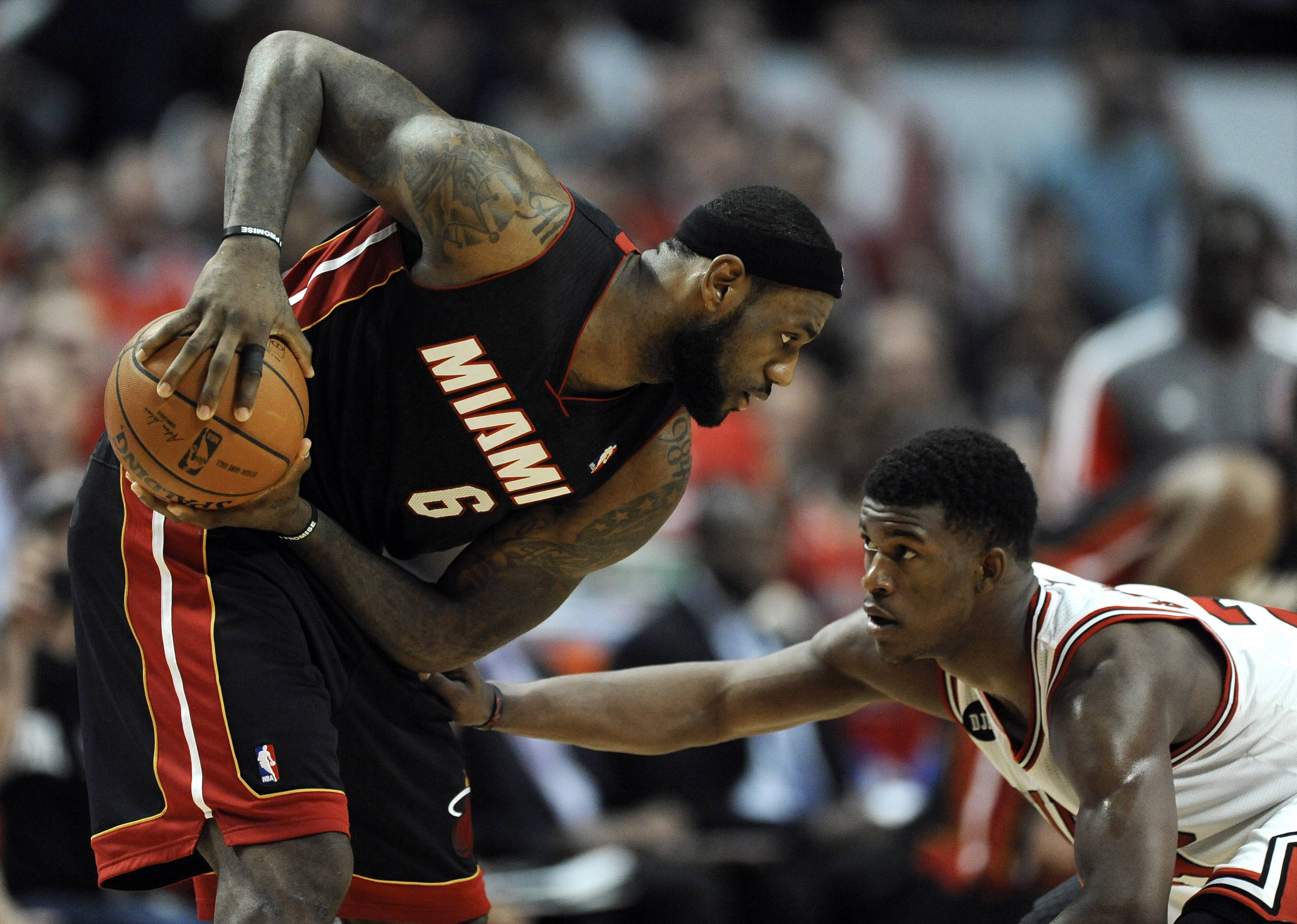 The Bulls' Jimmy Butler played combative defense for all 48 minutes he was on the floor Sunday, holding the Heat's LeBron James to just 17 points on 8-of-23 shooting.