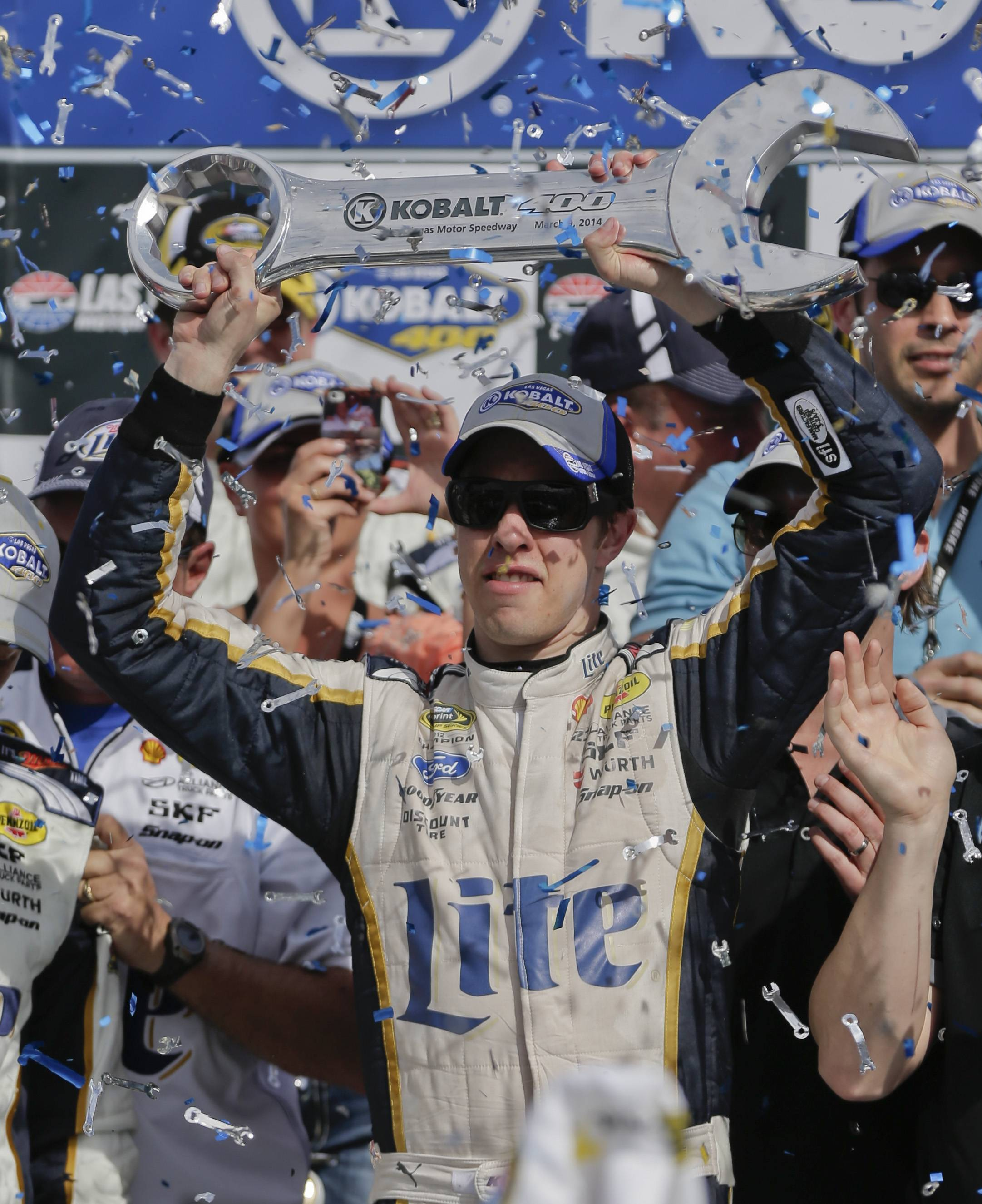 Brad Keselowski holds up the Kobalt 400 trophy after winning a NASCAR Sprint Cup Series auto race in Las Vegas. Keselowski overtook Dale Earnhardt Jr. on the last lap when Earnhardt ran out of fuel.