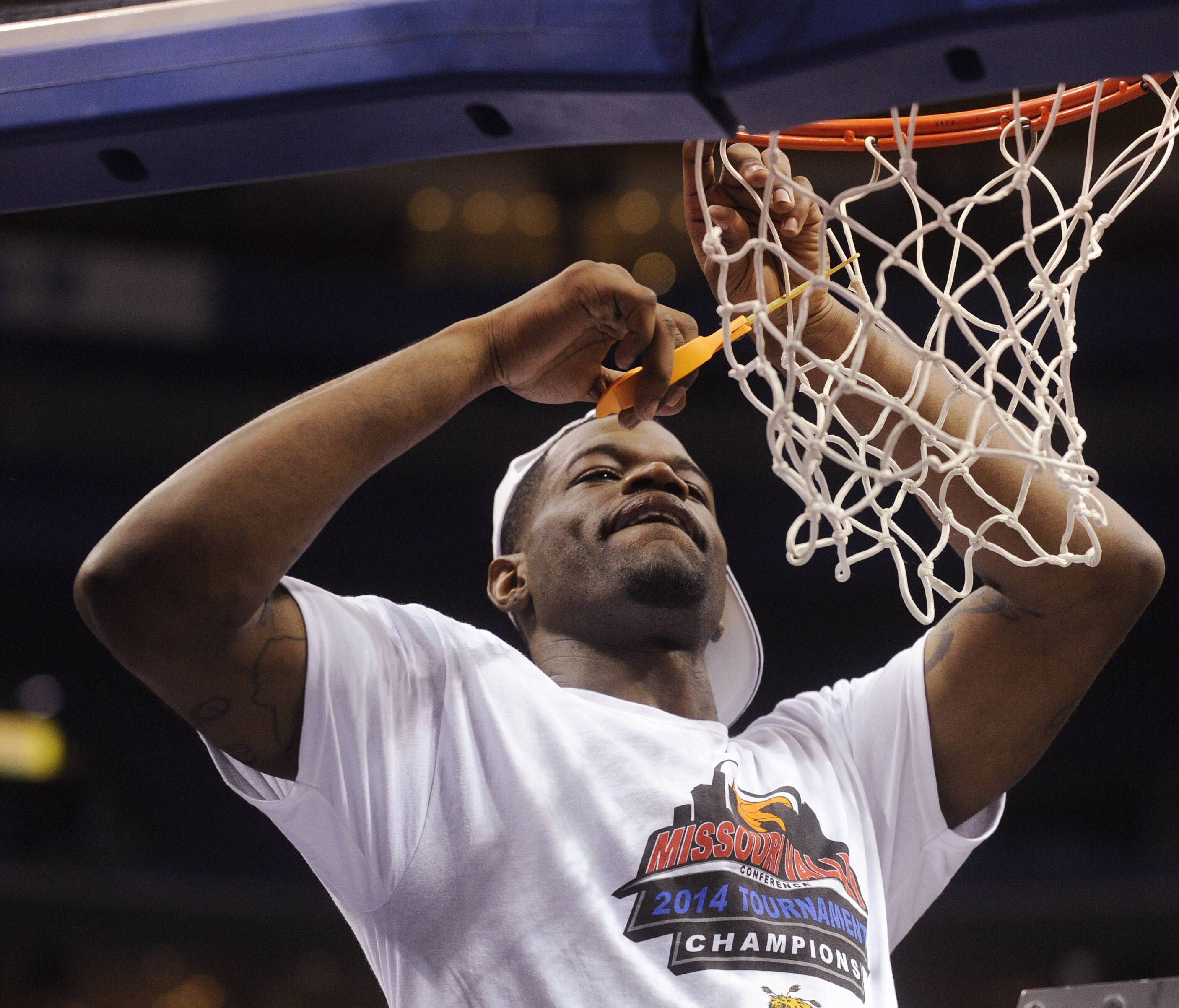 Wichita State's Chadrack Lufile cuts the net after Wichita's victory over Indiana State in an NCAA college basketball game in the championship of the Missouri Valley Conference men's tournament Sunday in St. Louis.