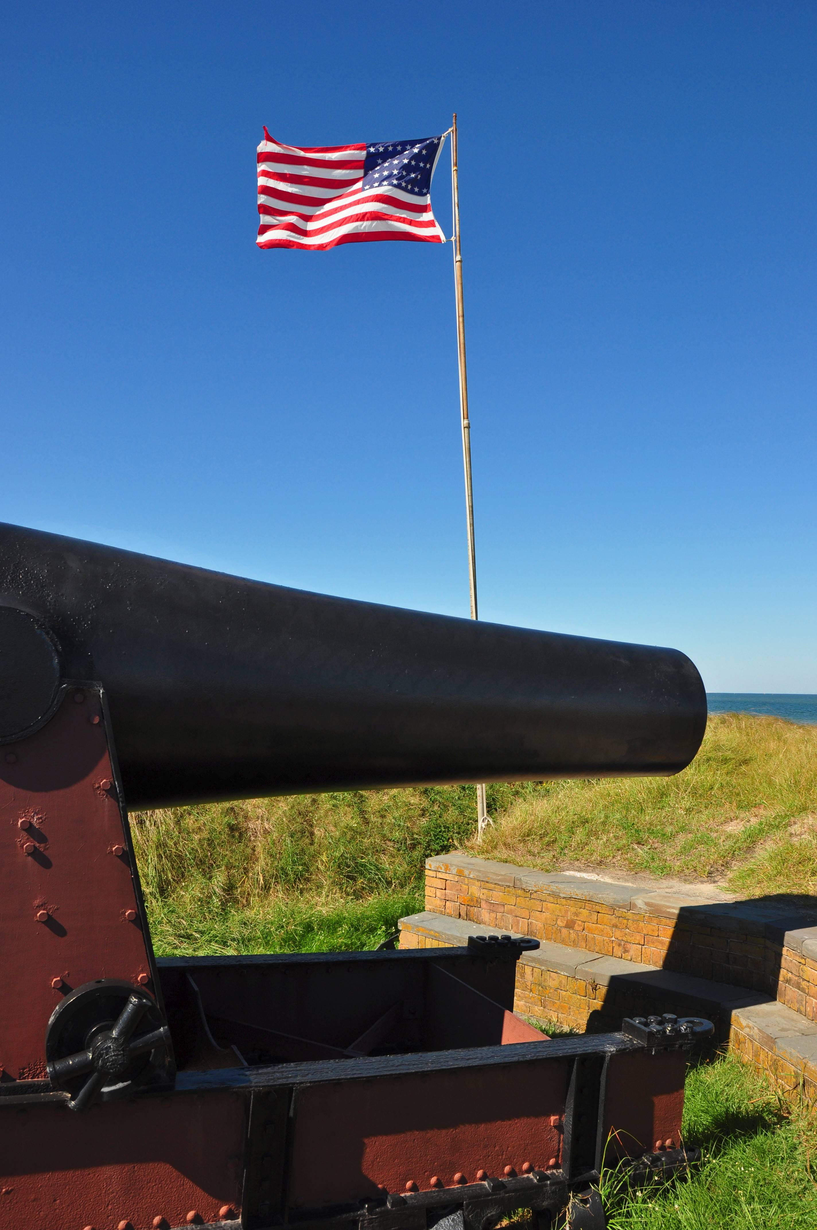A Rodman cannon has been preserved at Fort Massachusetts, which flies a U.S. flag with 36 stars, the number of states in the Union in 1866.