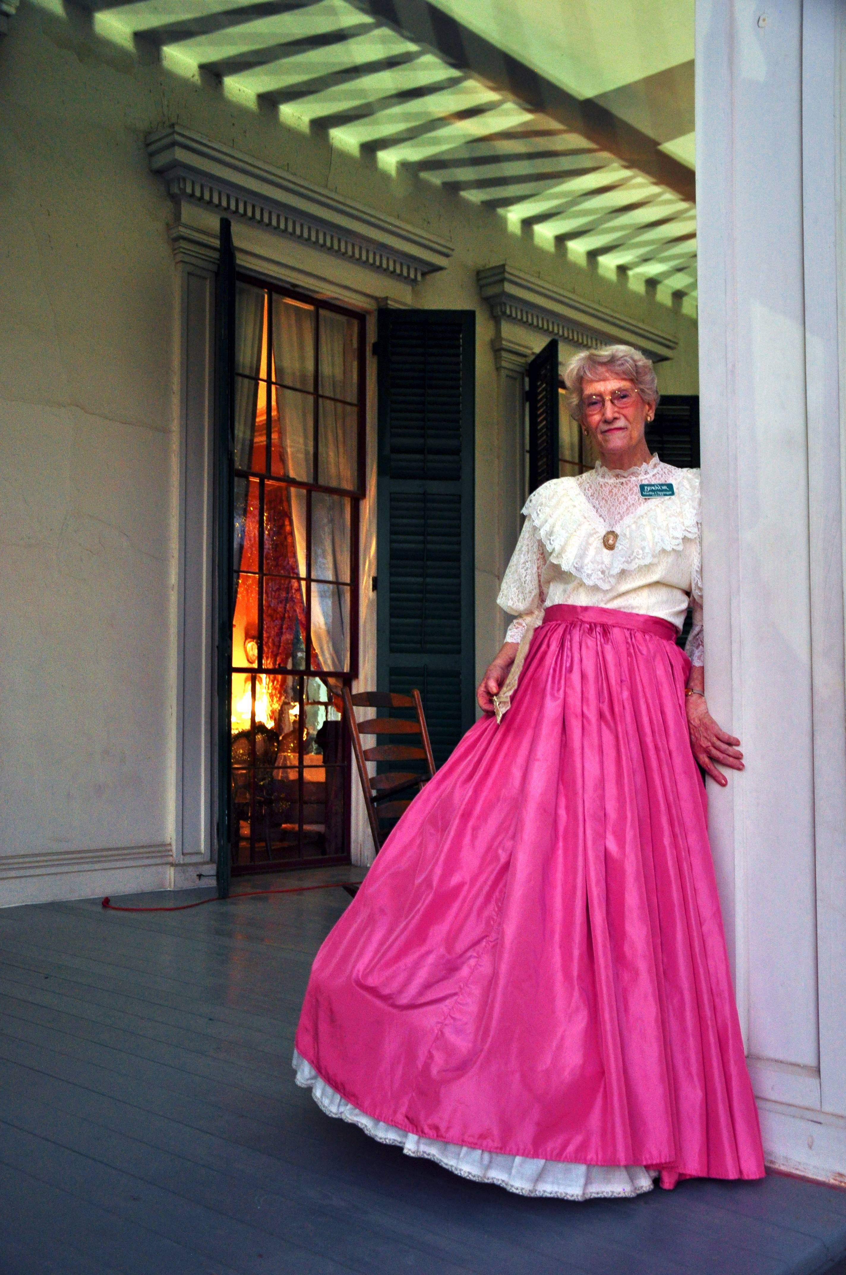 A guide dressed in antebellum costume greets visitors to Beauvoir, the home of Confederate President Jefferson Davis.