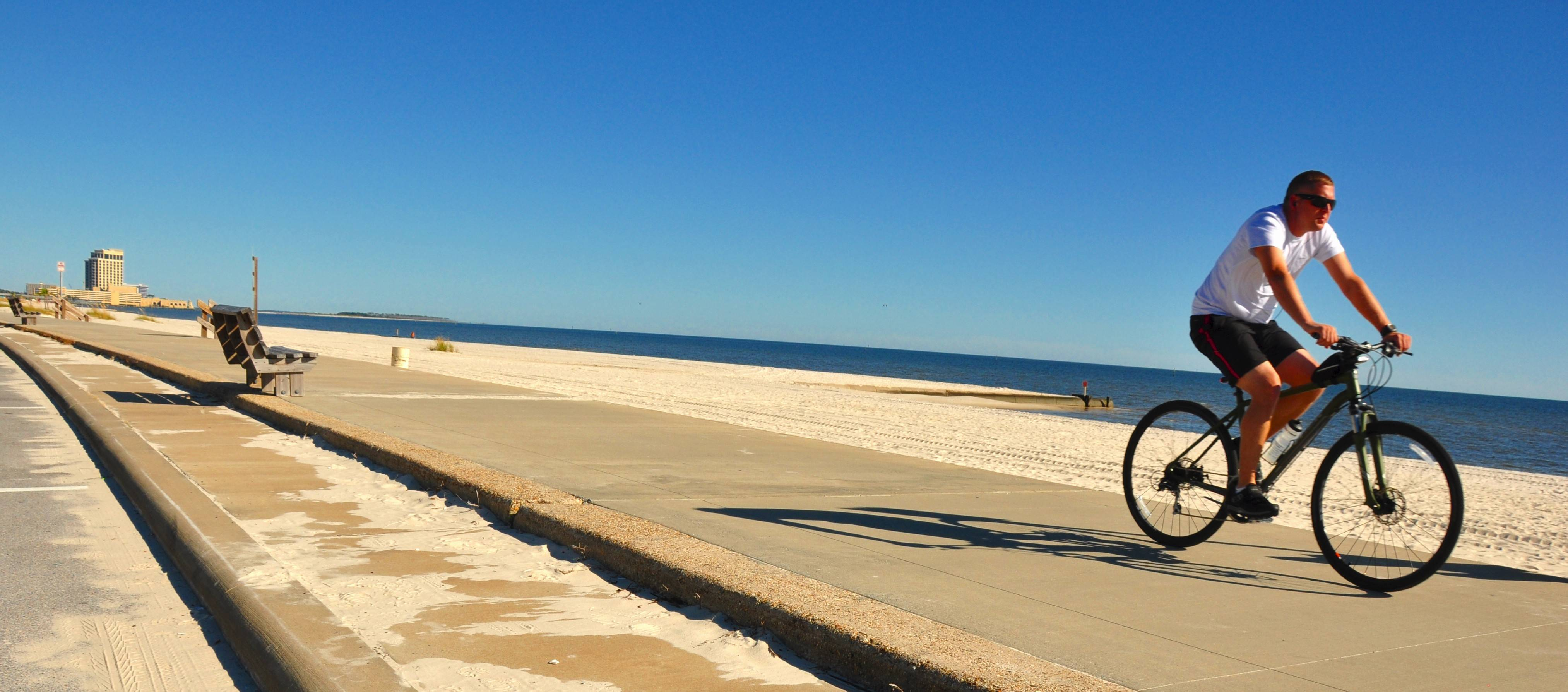 The beach along the Mississippi Sound stretches for 26 miles with a walkway for joggers and bicyclists.