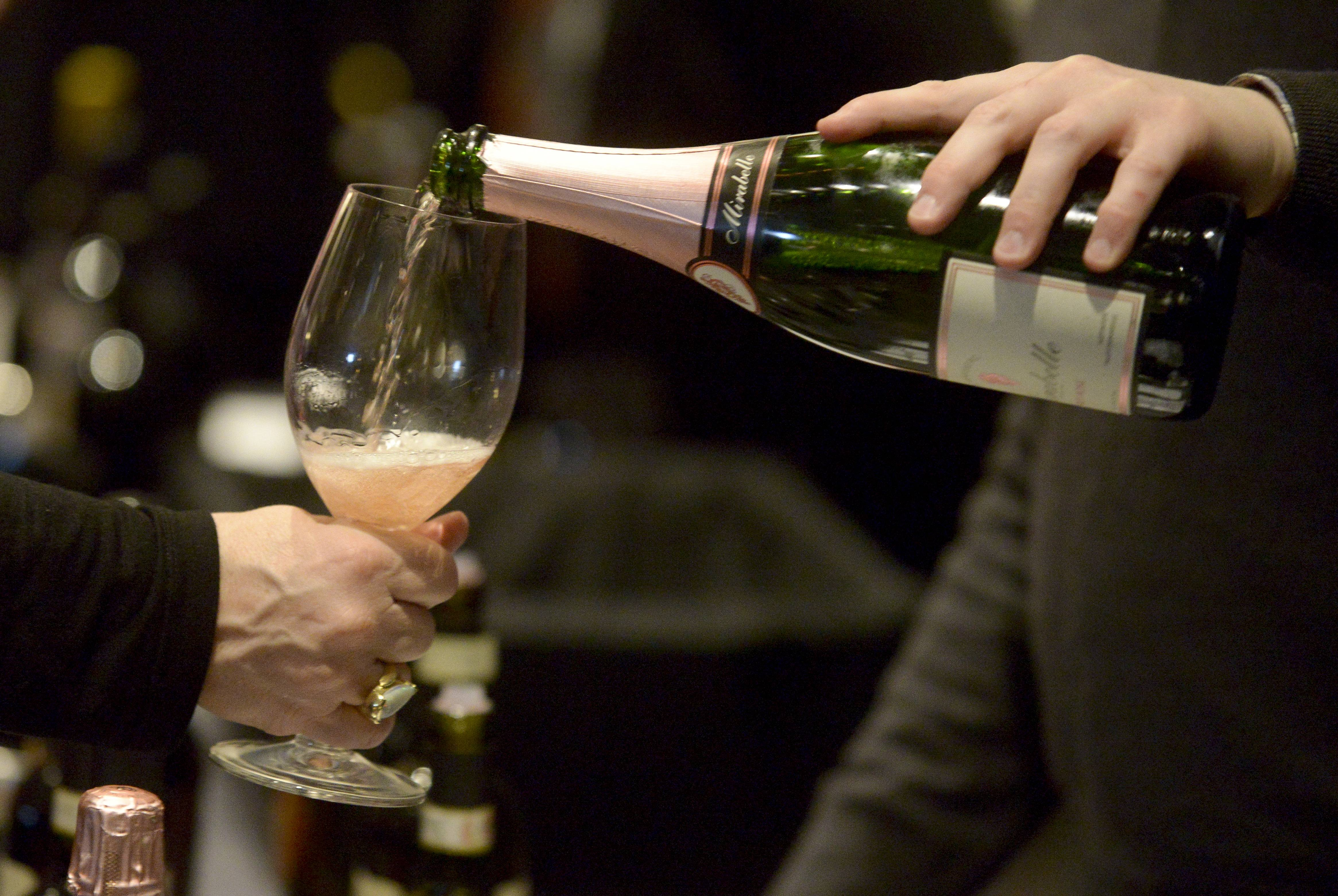 A Schramsberg Mirabelle sparkling wine is poured during the Naperville Winter Wine Festival at the Hotel Arista in Naperville. A portion of proceeds from the event was donated to DuPage PADS.